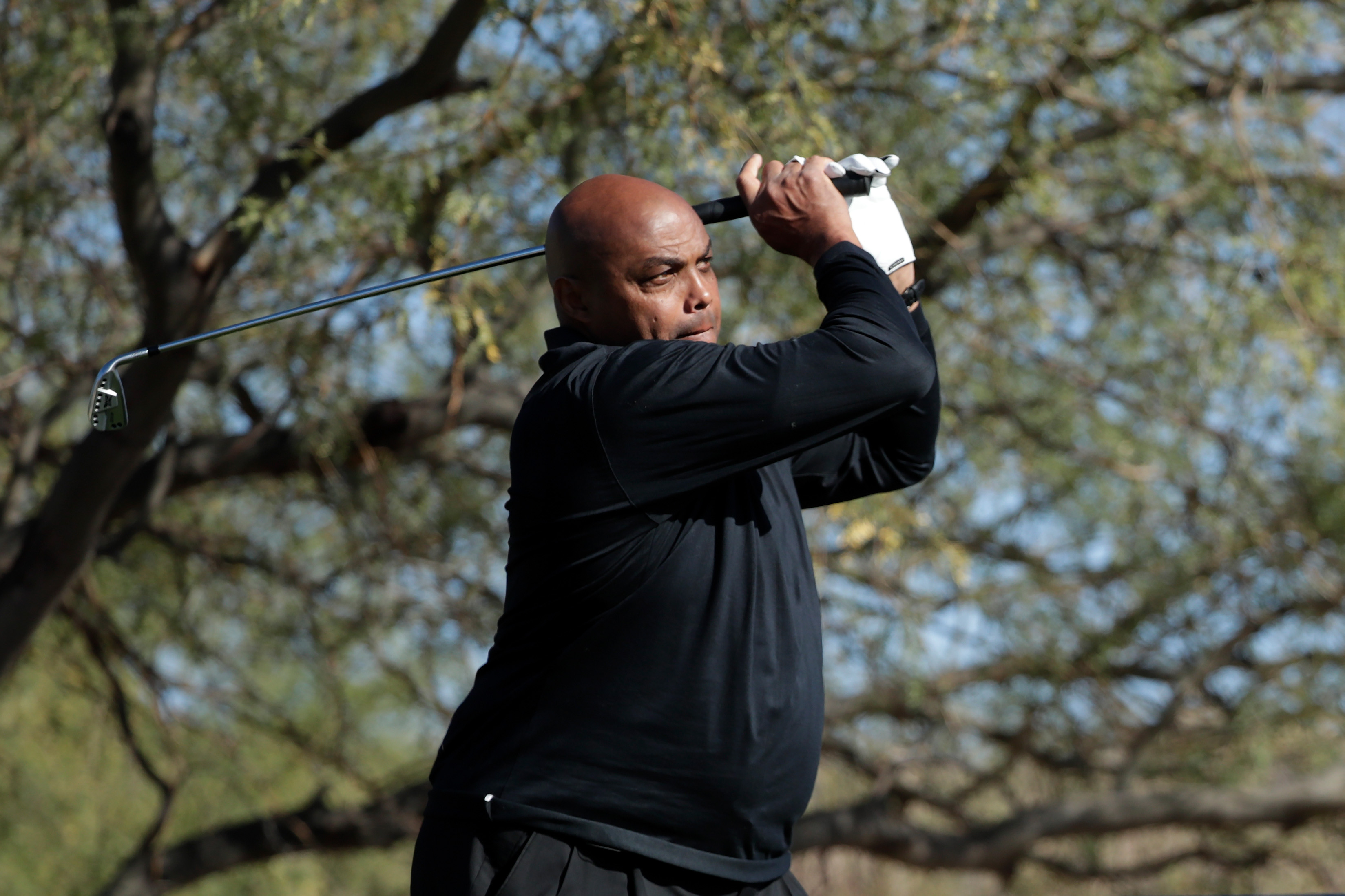 Charles Barkley plays his shot from the first tee