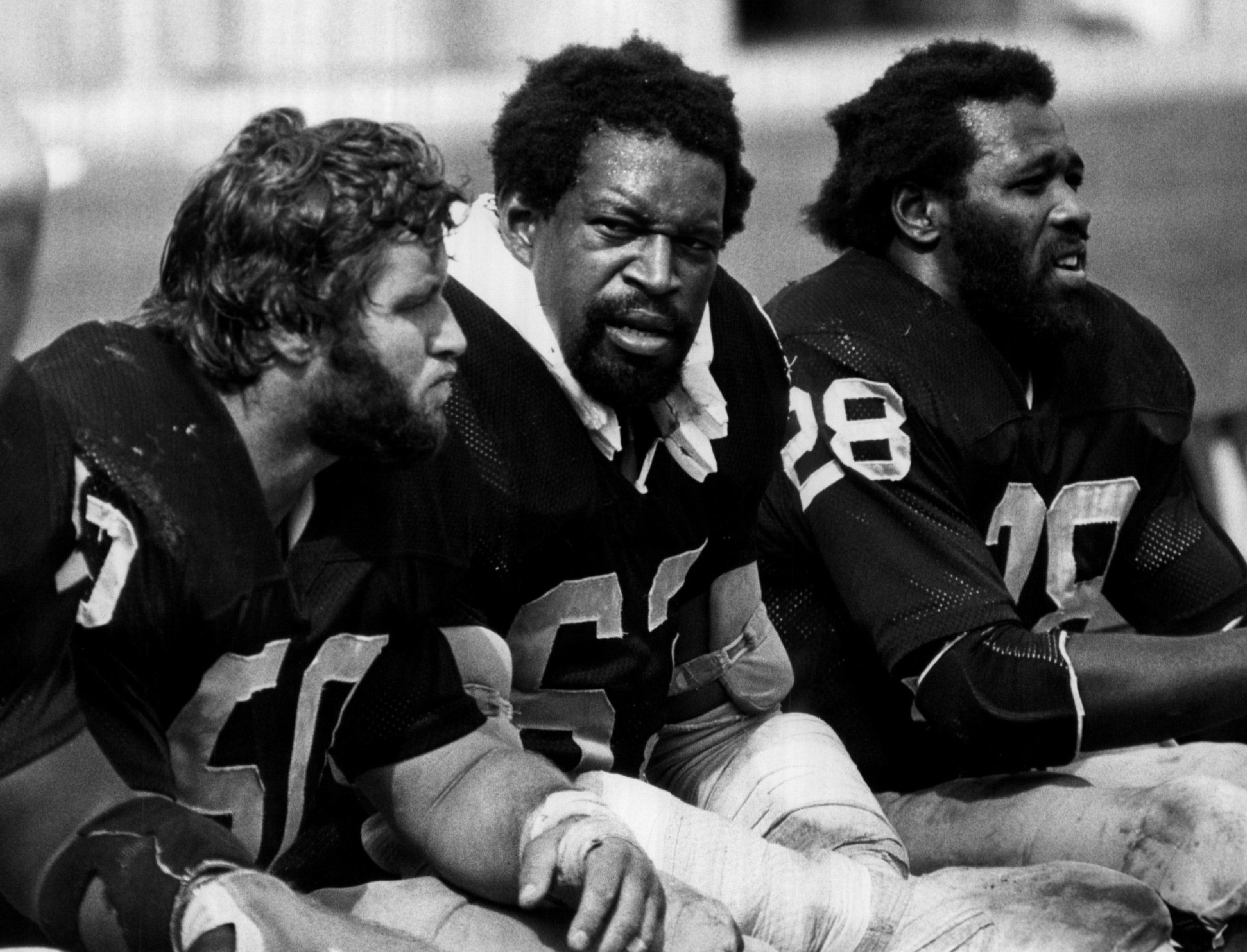 Clarence Davis, Gene Upshaw, and Dave Dalby of the Oakland Raiders in 1977