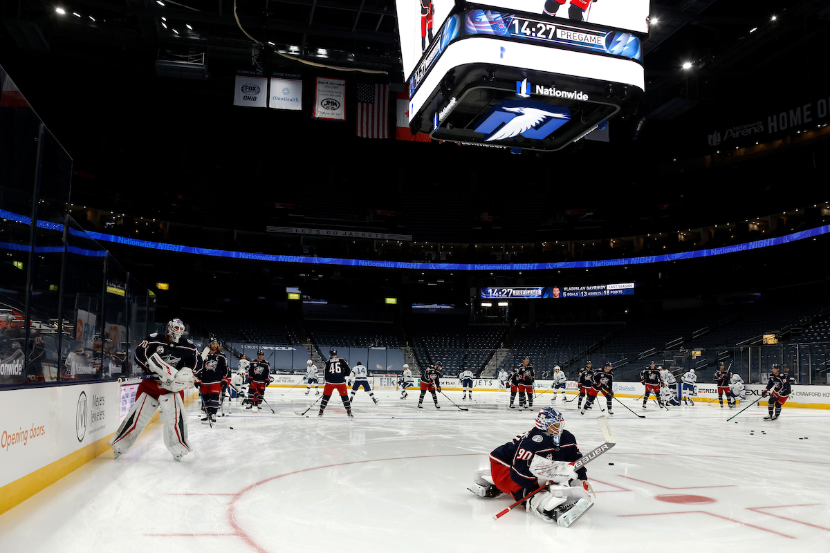 Elvis Merzlikins of the Columbus Blue Jackets stretches prior to the start of a game
