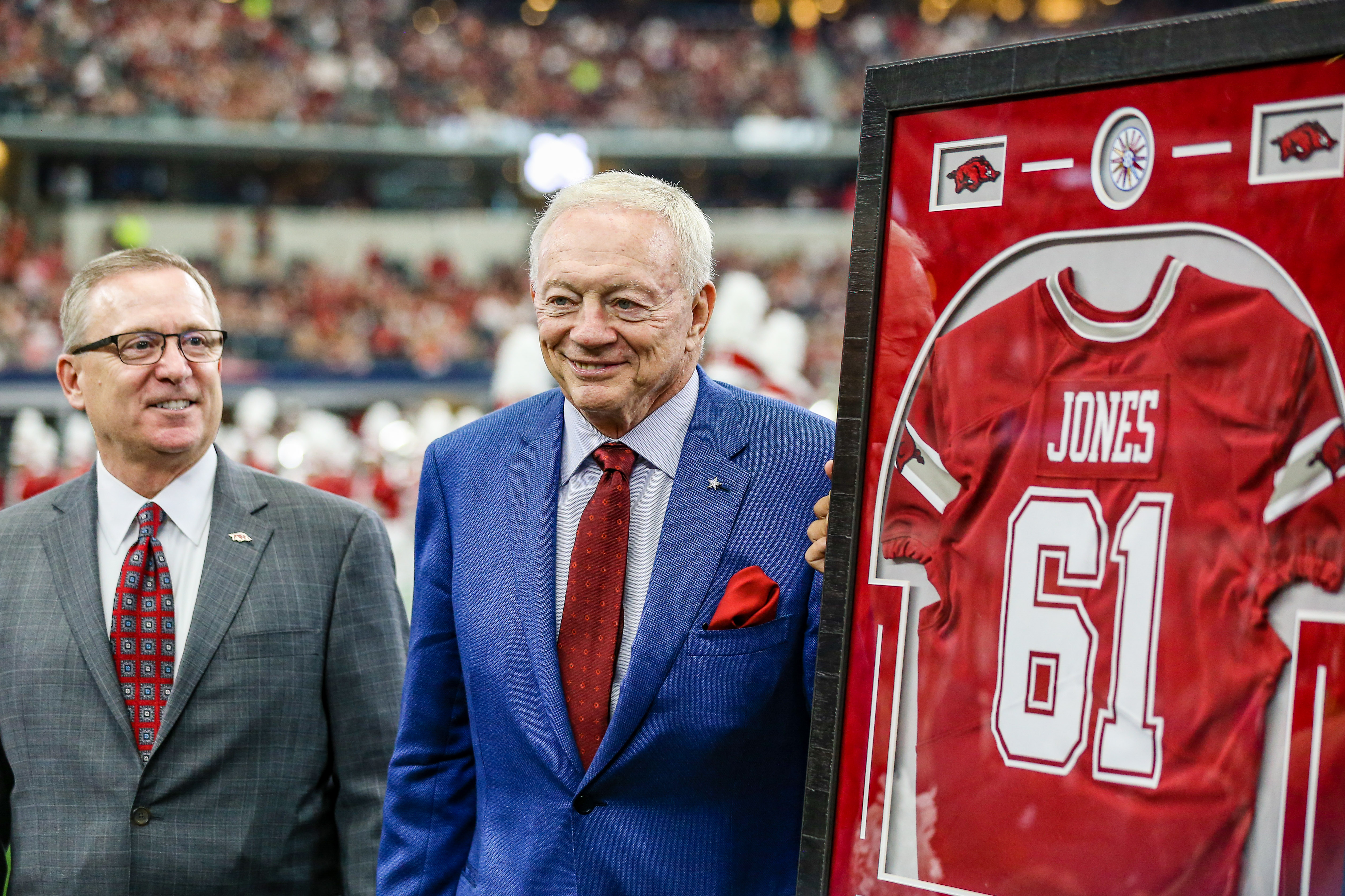 Dallas Cowboys owner Jerry Jones gets a Arkansas Razorbacks Jersey for the 1961 Arkansas National Championship team