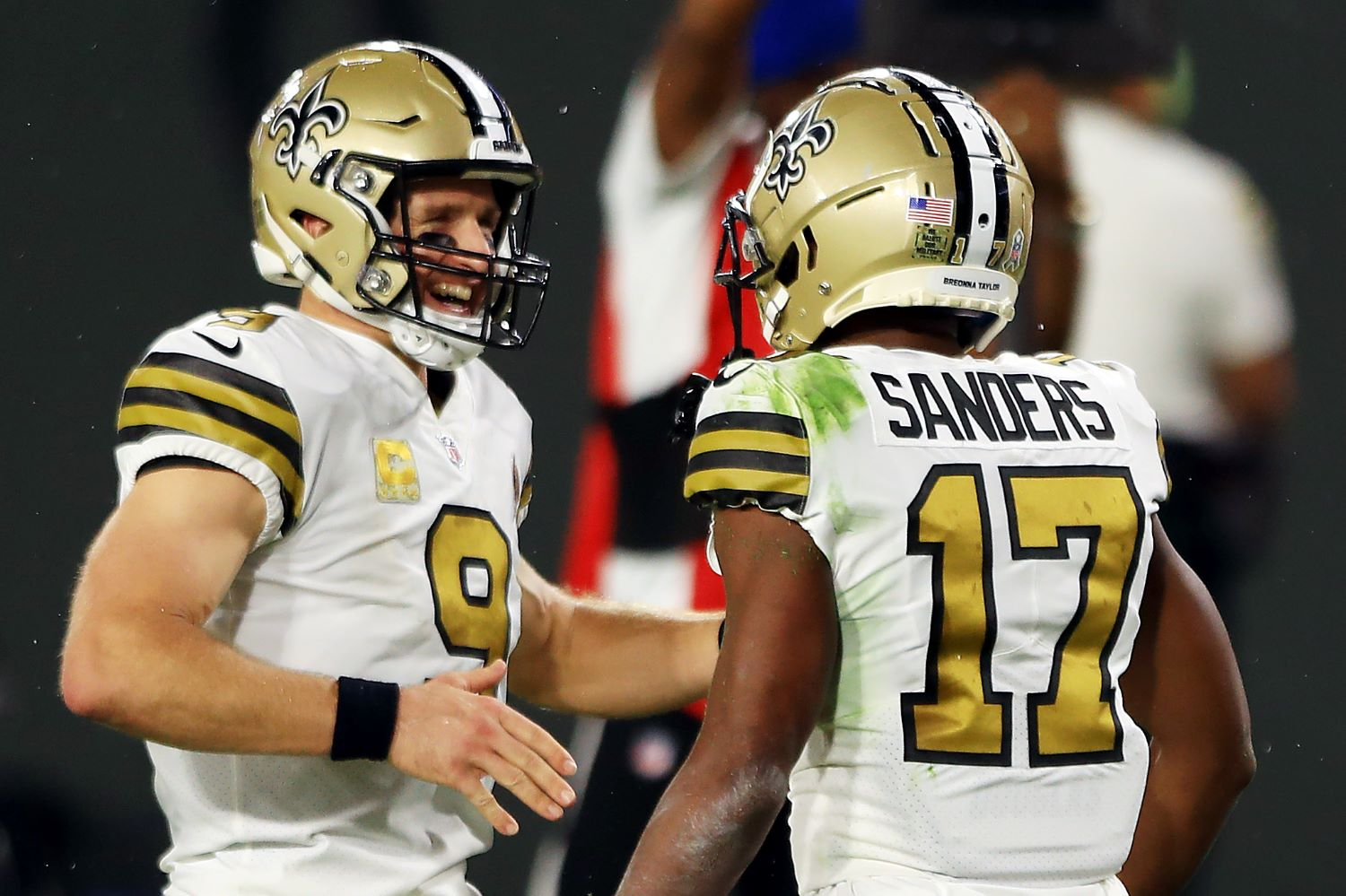 Drew Brees helped one of his New Orleans Saints teammates earn a $500,000 bonus in Sunday's 33-7 win against the Carolina Panthers.
