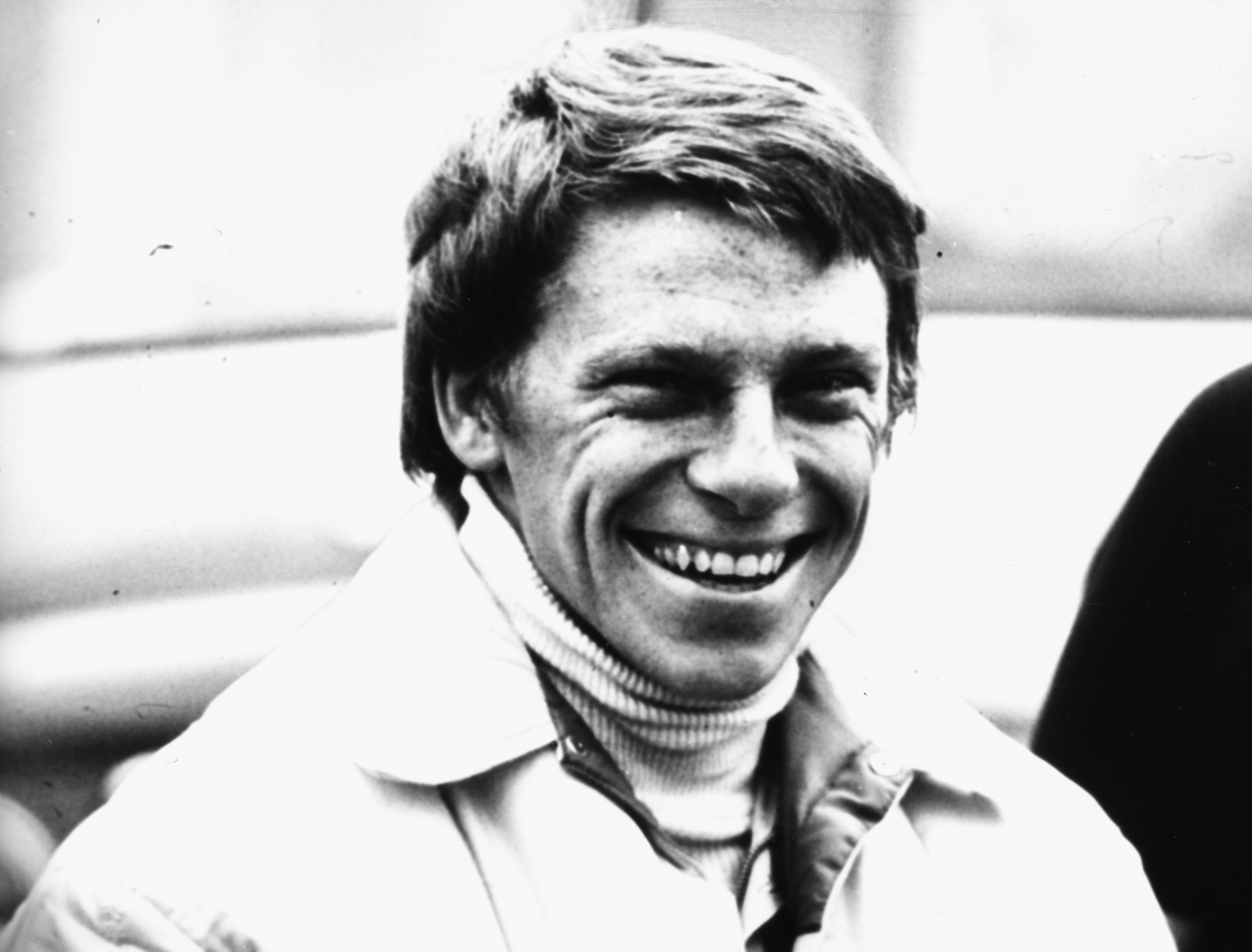 Driver Roger Williamson laughing, prior to his death at 25 years old