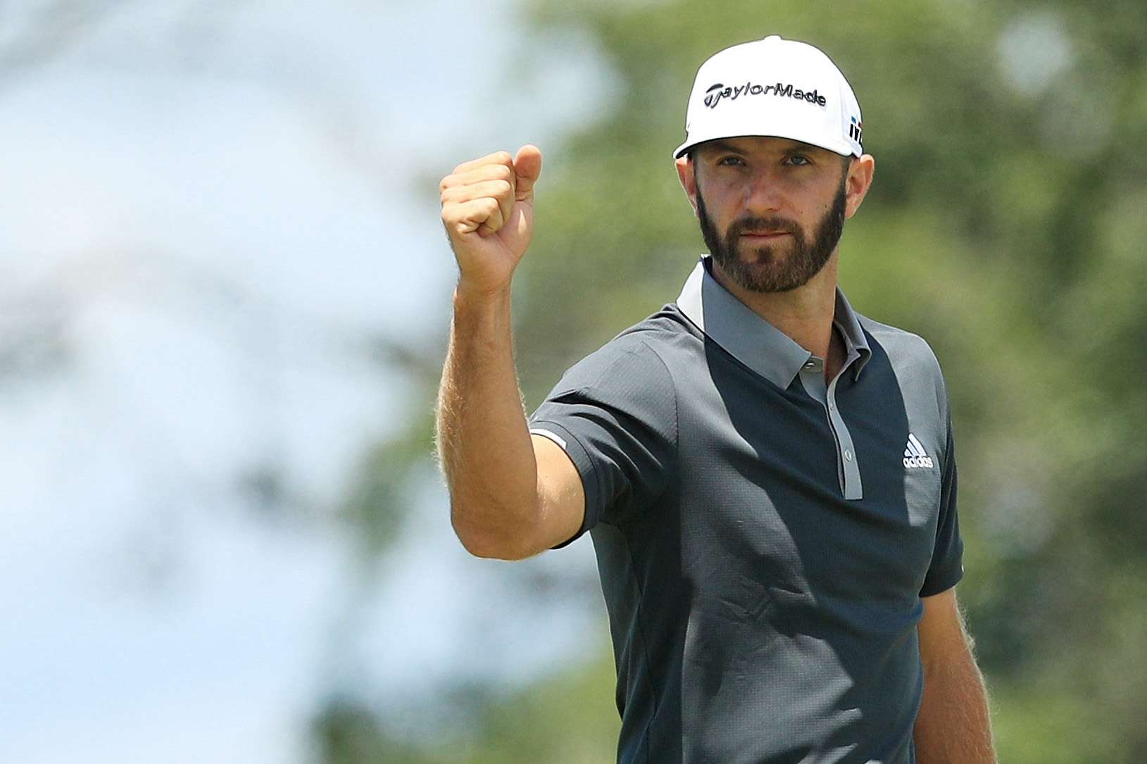 Golfer Dustin Johnson celebrates after making a birdie on the seventh hole during the second round of the 2018 U.S. Open at Shinnecock Hills Golf Club on June 15, 2018, in Southampton, New York.