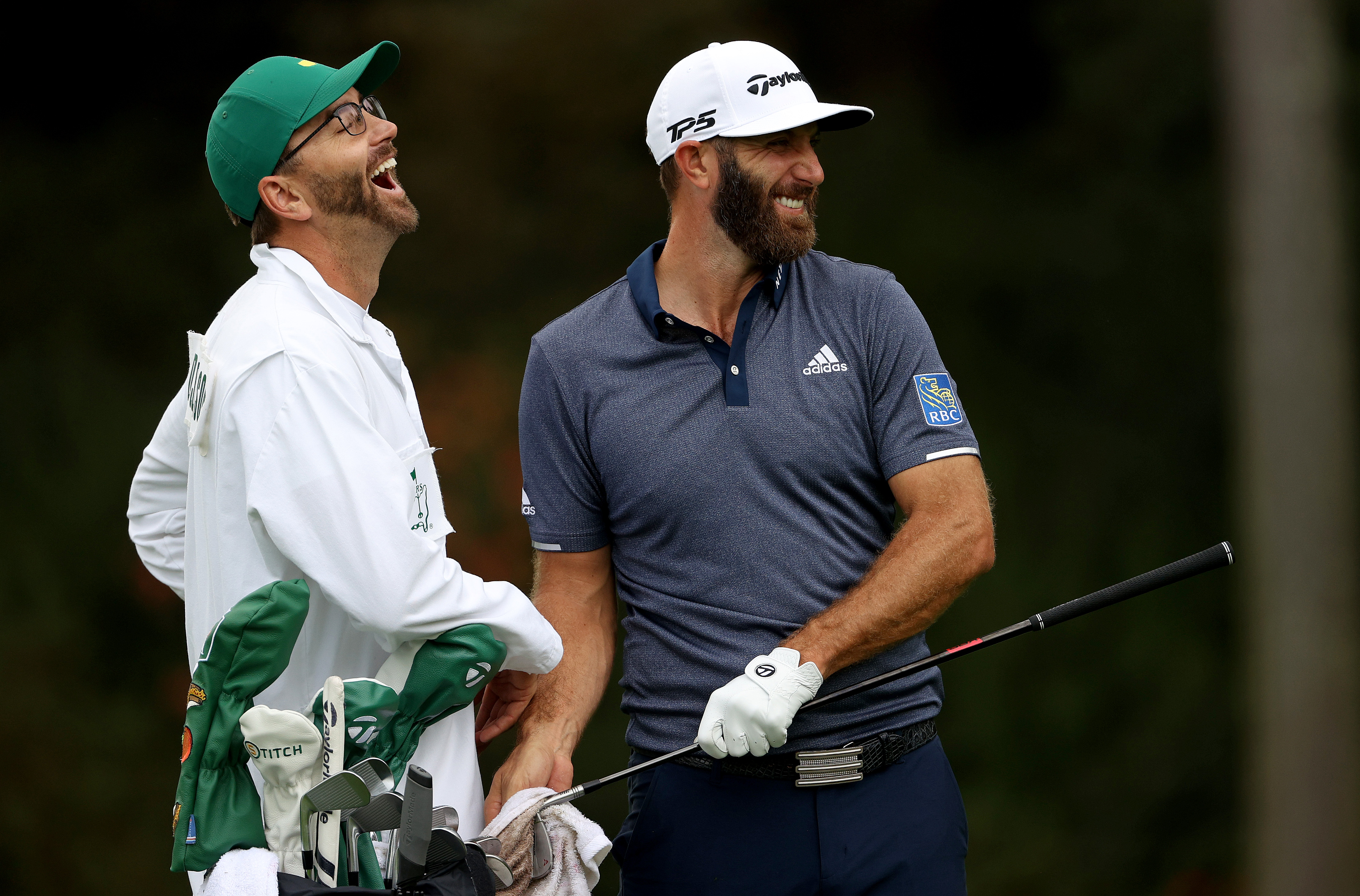 Dustin Johnson talks with his caddie and brother Austin Johnson