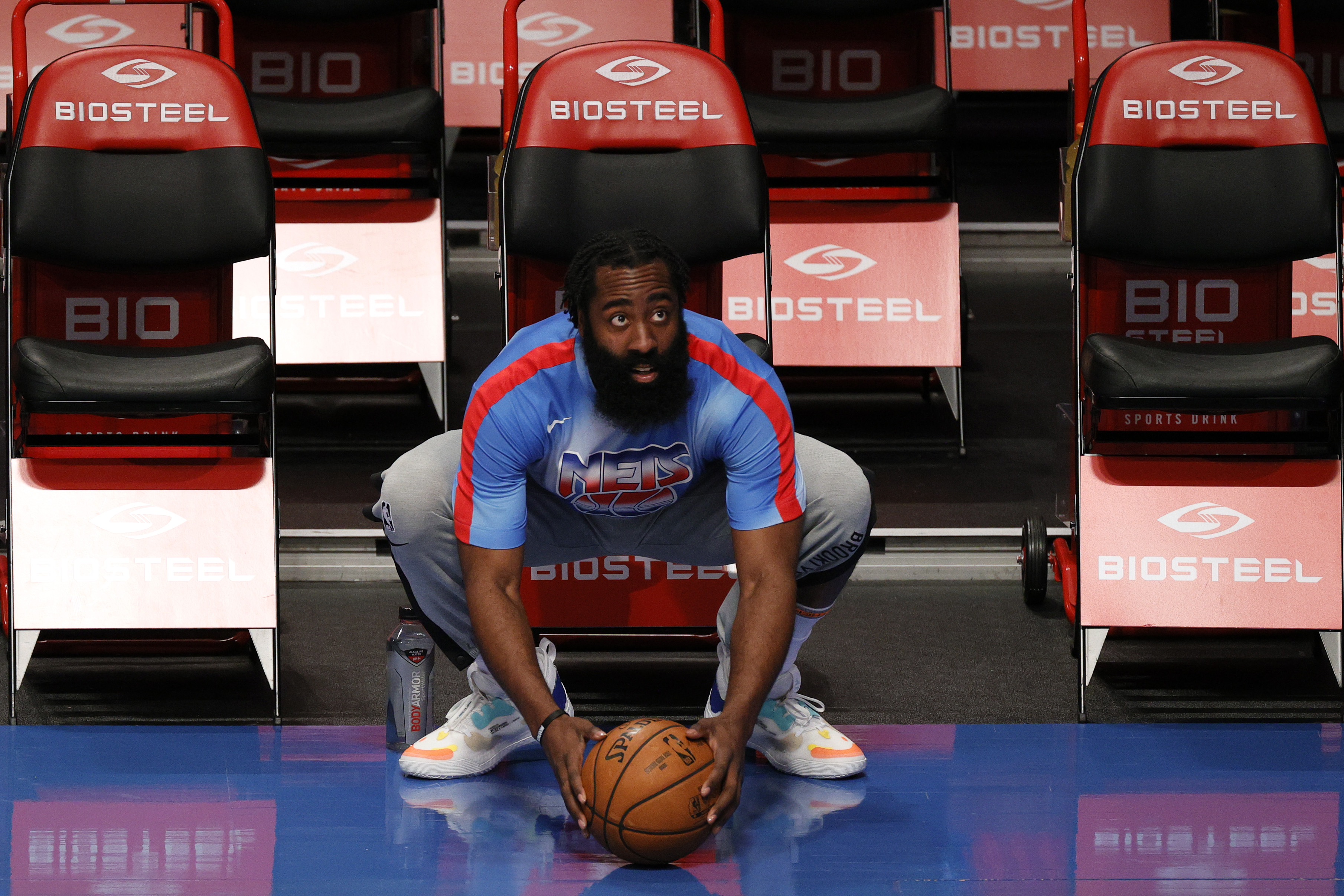 James Harden of the Brooklyn Nets looks on before a game