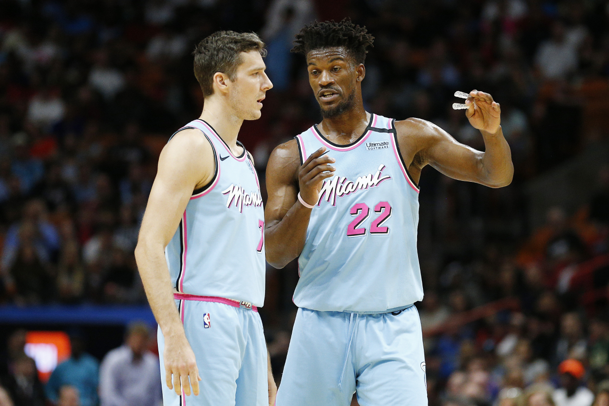 Jimmy Butler and Goran Dragic talking during a game