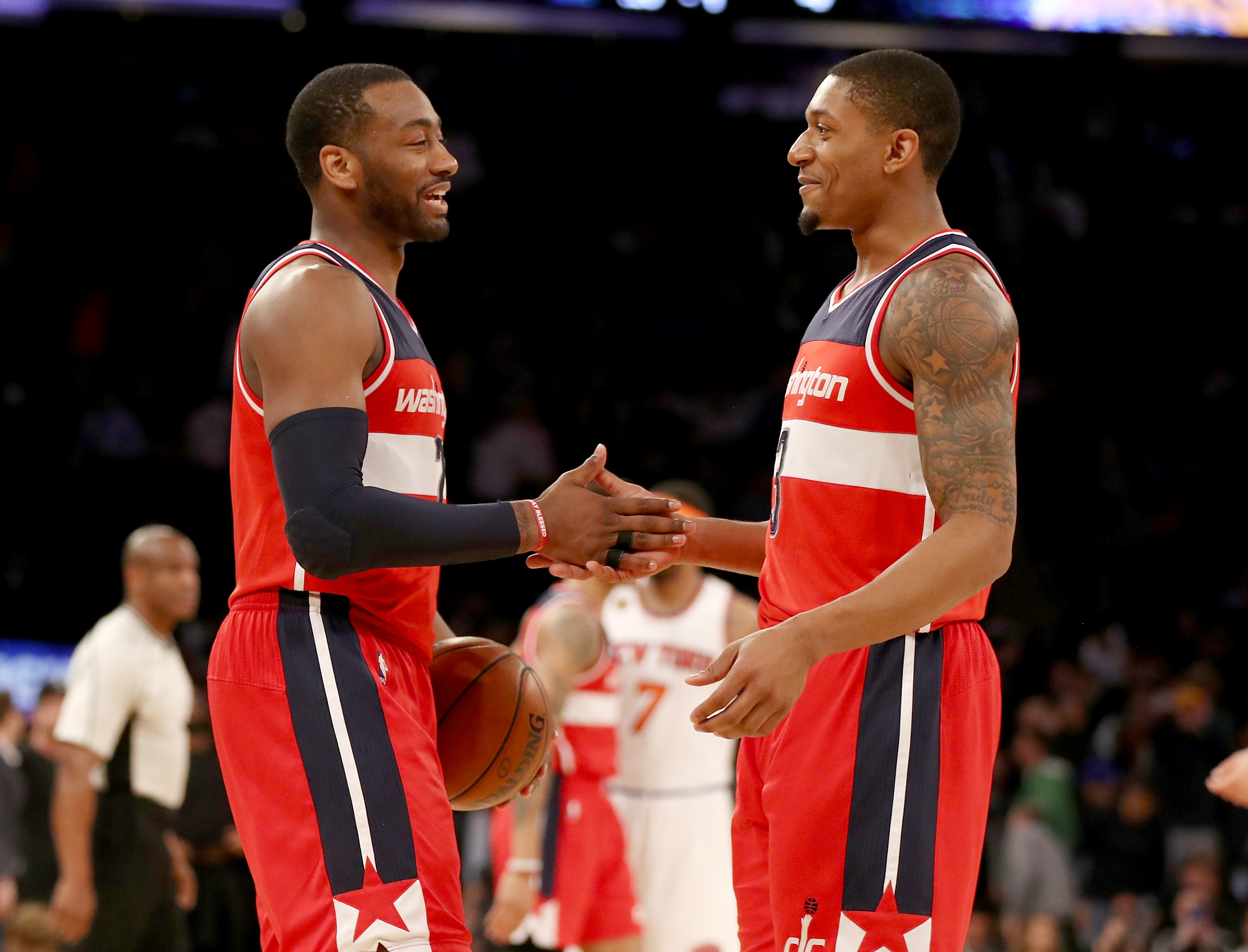 John Wall and Bradley Beal embrace on the court