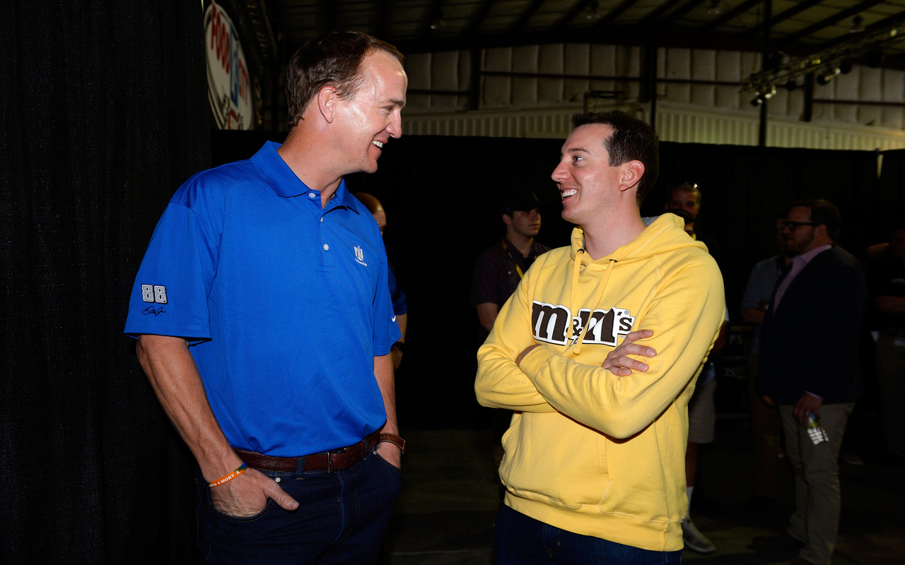Longtime NFL quarterback Peyton Manning (L) spent time with NASCAR's Kyle Busch at the Food City 500 in April 2016.