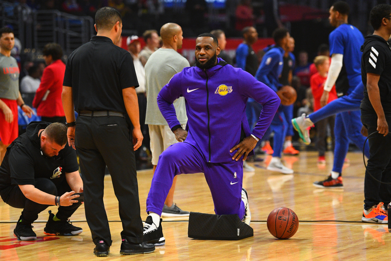 LeBron James stretching before a Lakers gmae