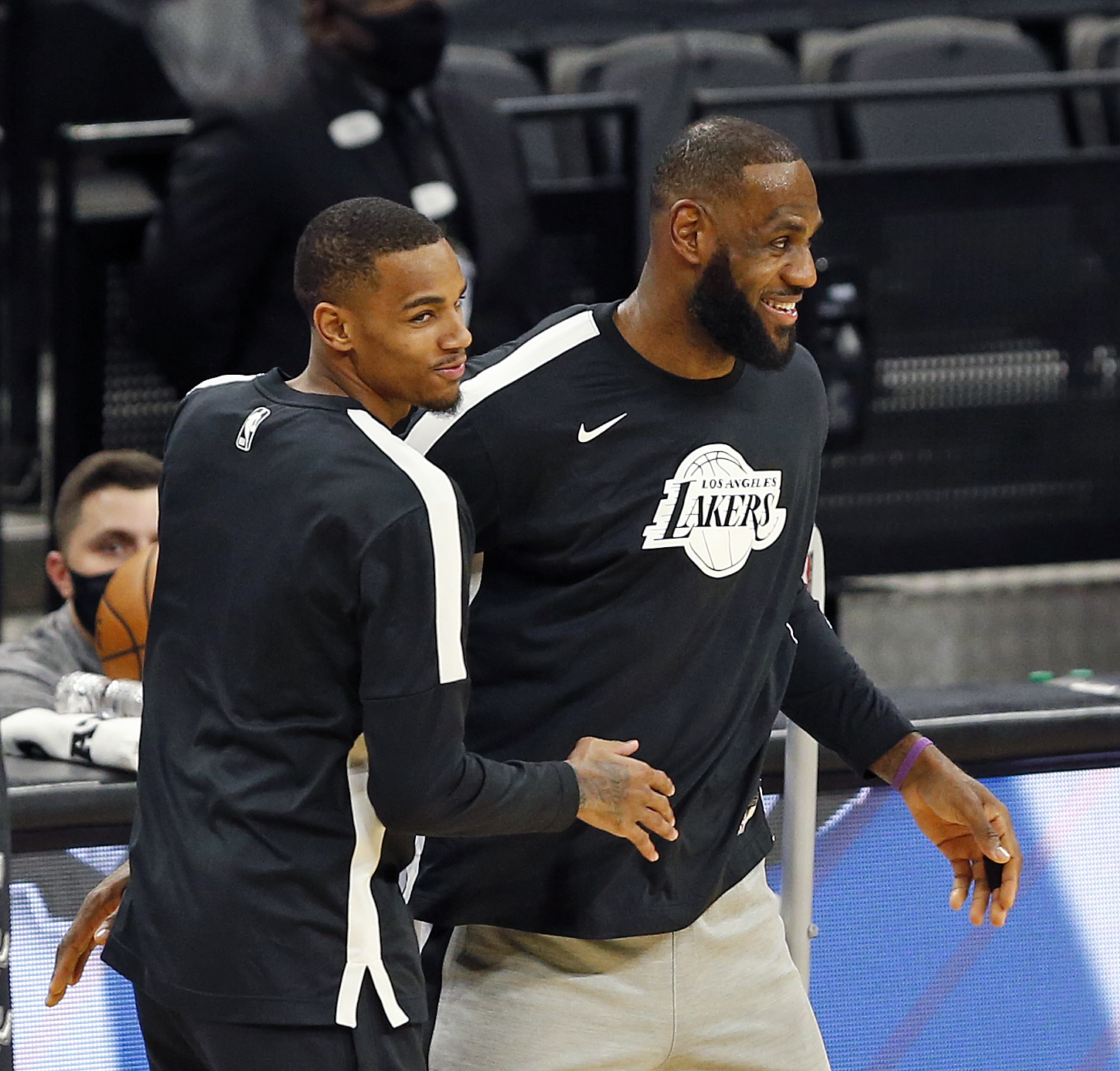 Dejounte Murray of the Spurs greets LeBron James of the Los Angeles Lakers