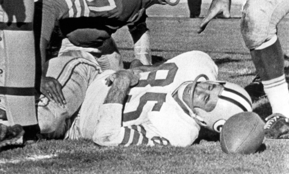 Max McGee lies unconscious after scoring a touchdown and colliding with the goal post on the field at Kezar Stadium, San Francisco, California, on December 10, 1961.