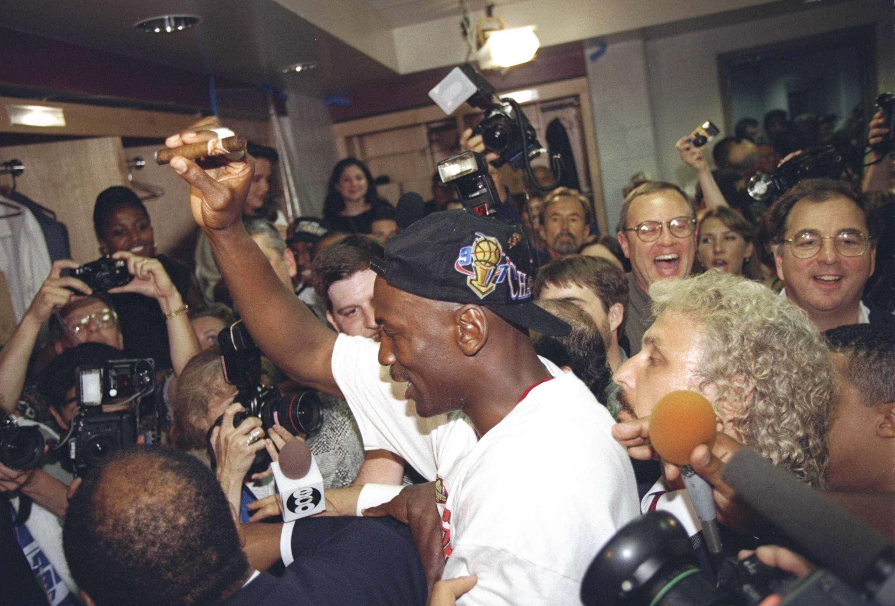 Michael Jordan of the Chicago Bulls celebrates in the locker room after winning the 1997 NBA Finals