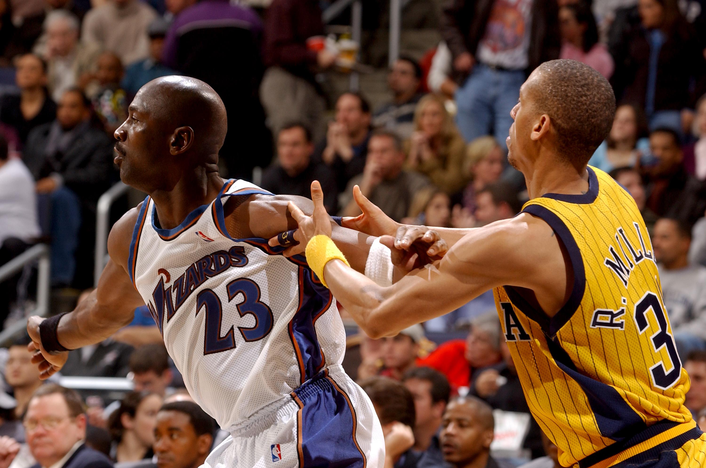 Reggie Miller guards Michael Jordan during an NBA game