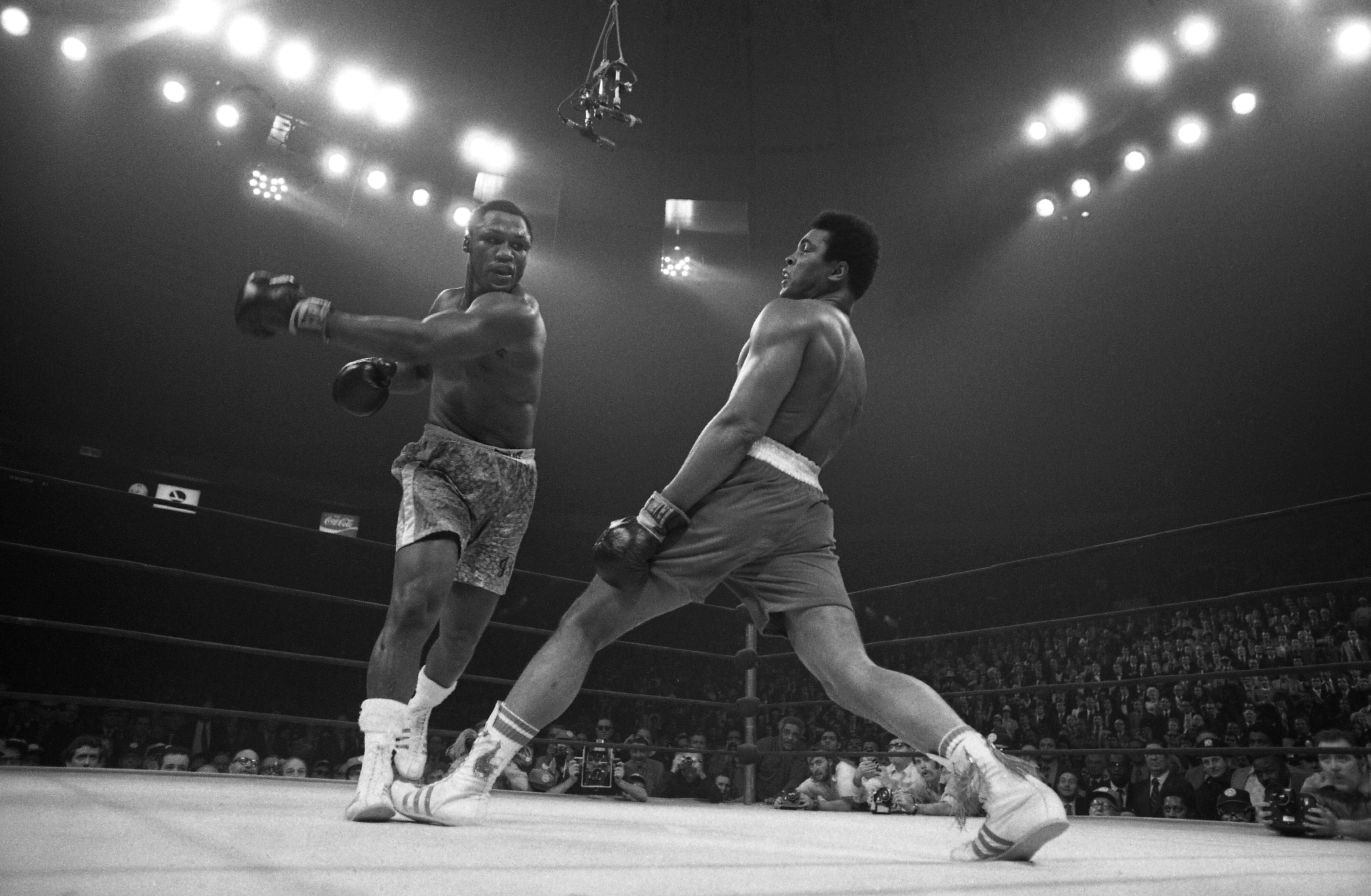 Joe Frazier tries to punch Muhammad Ali
