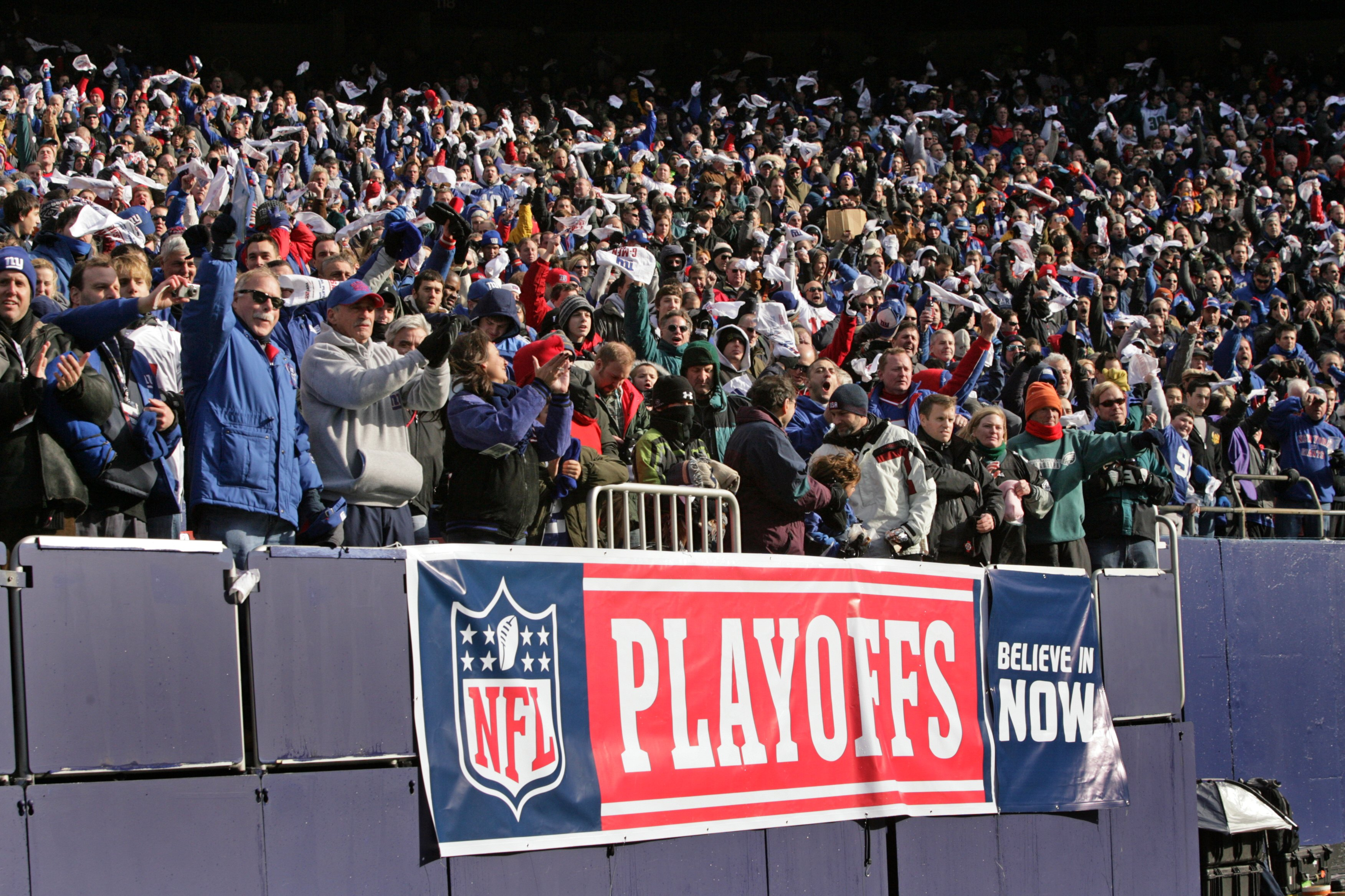 Fans in the crowd cheer during an NFL Playoff game