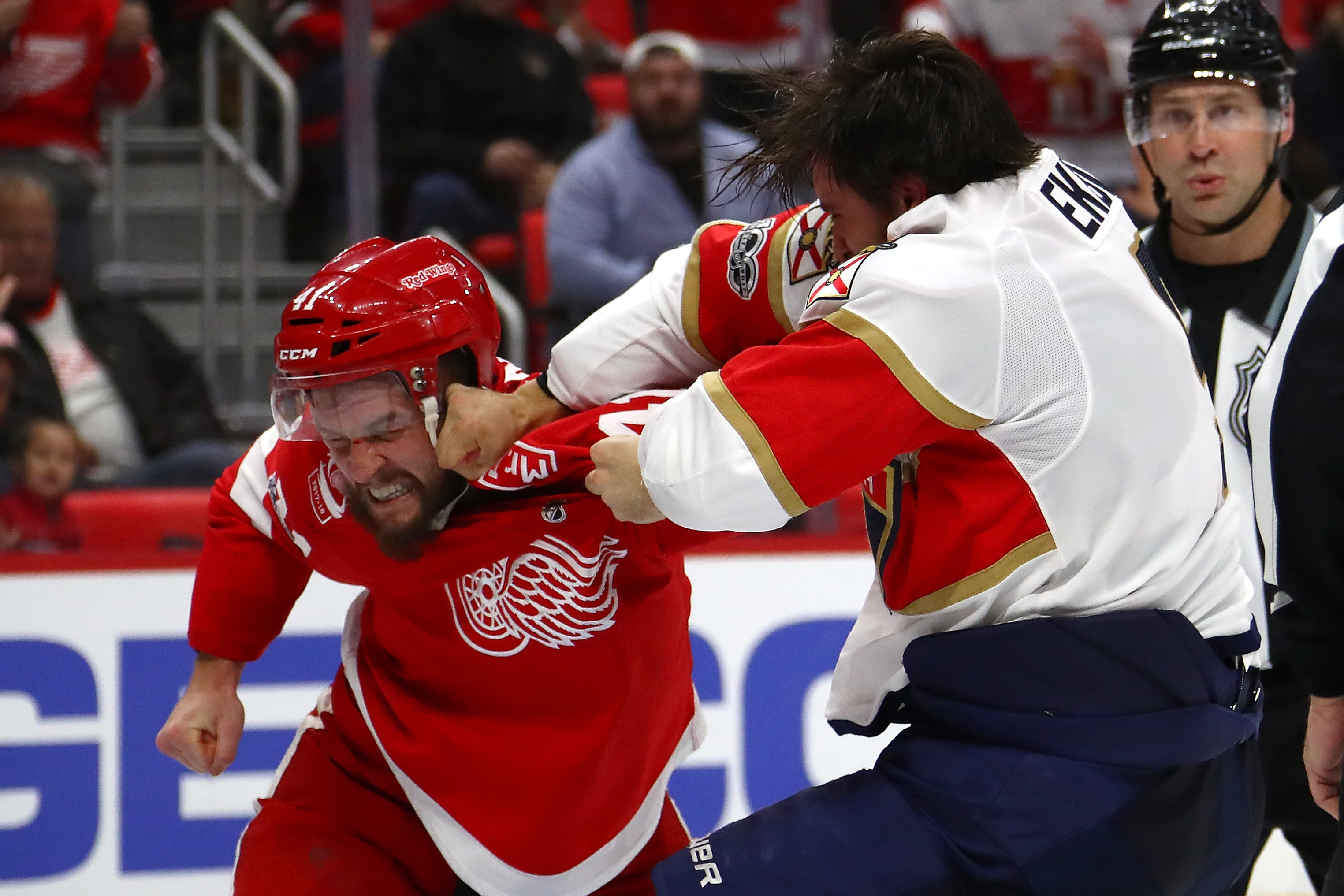 Two NHL players engage in a fight