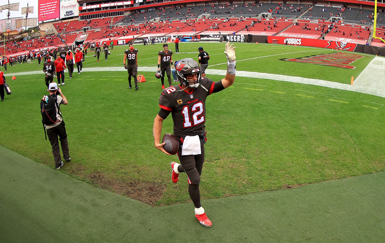 Tom Brady of the Tampa Bay Buccaneers walks off the field