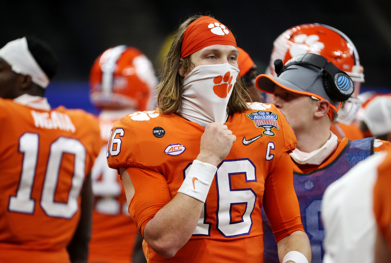 Trevor Lawrence looks on from the Clemson sideline