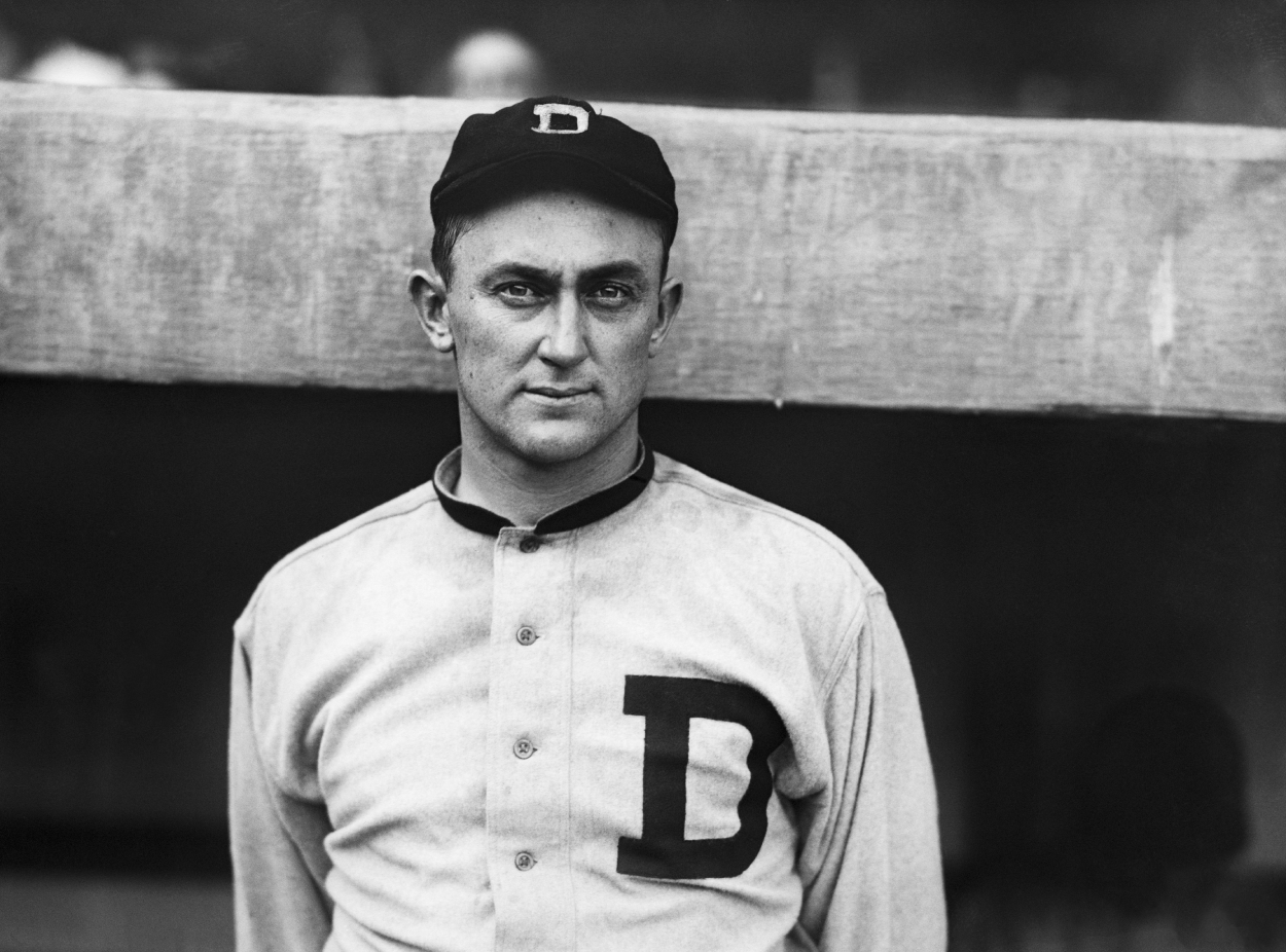 Ty Cobb poses for a picture outside the dugout