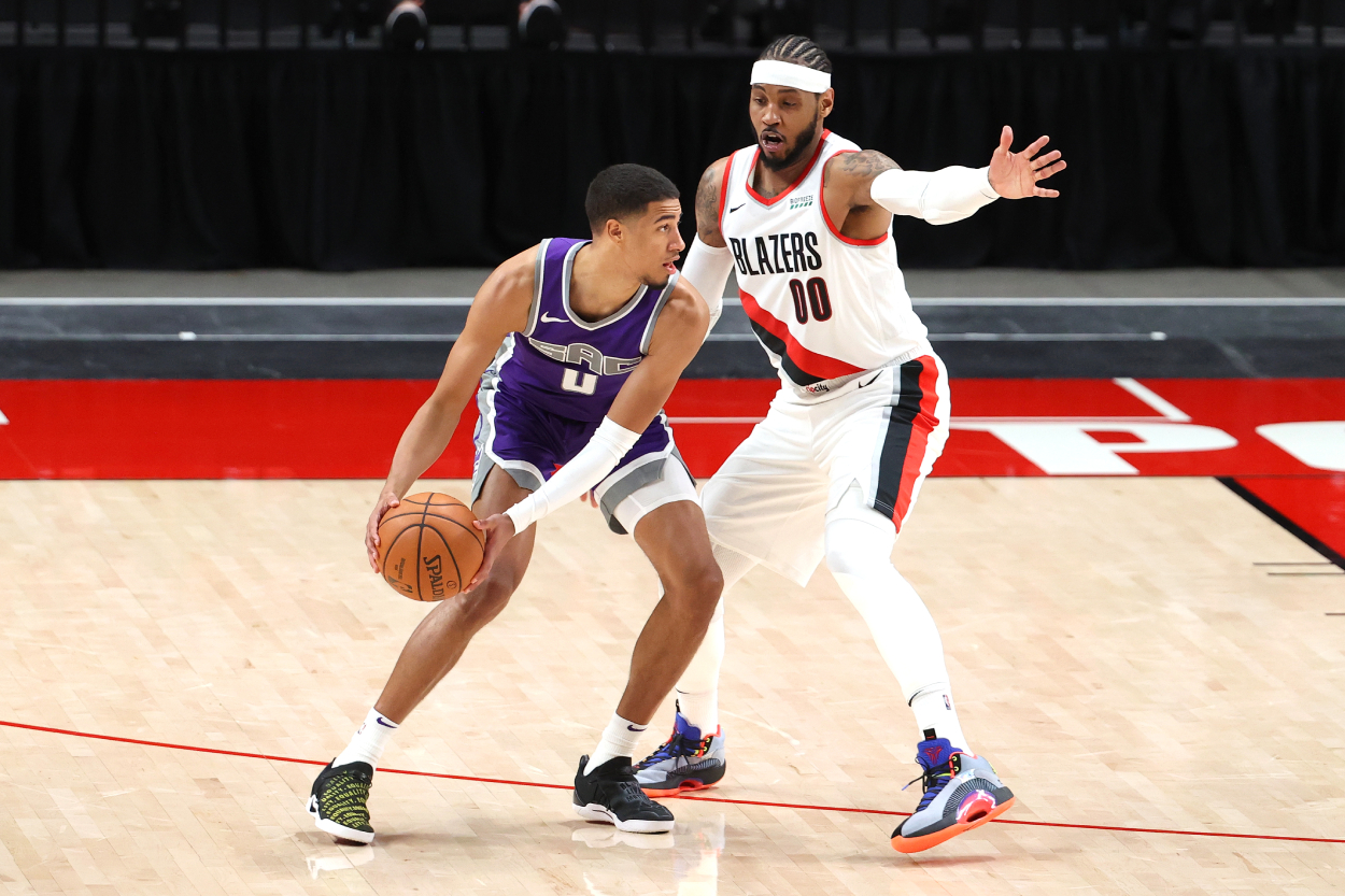 Tyrese Haliburton holds the ball during a Kings game