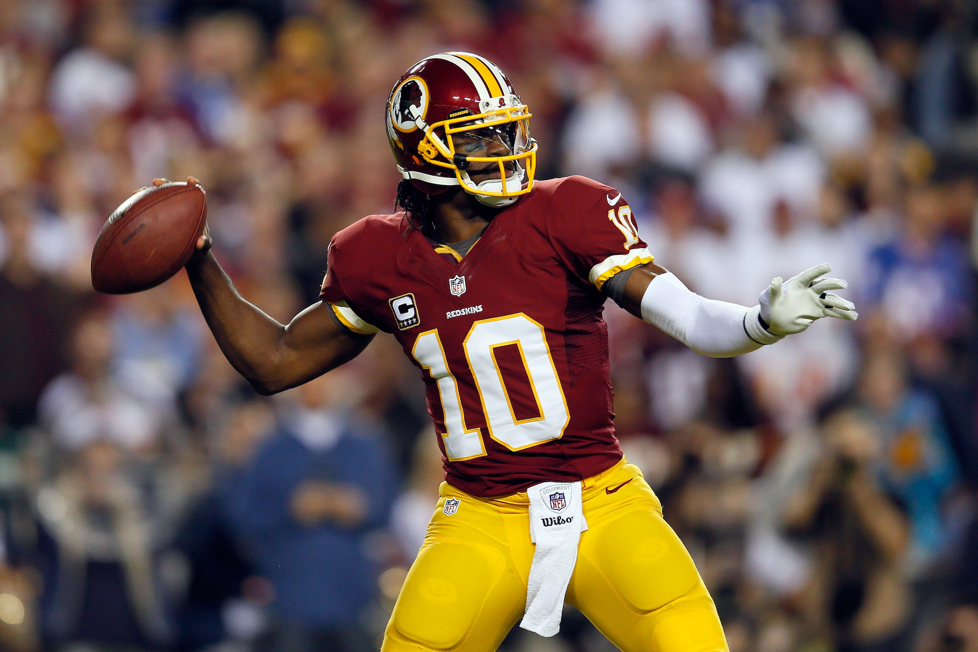Quarterback Robert Griffin III, #10 of the Washington Redskins, throws the ball in the first quarter while taking on the New York Giants at FedExField on December 3, 2012, in Landover, Maryland.