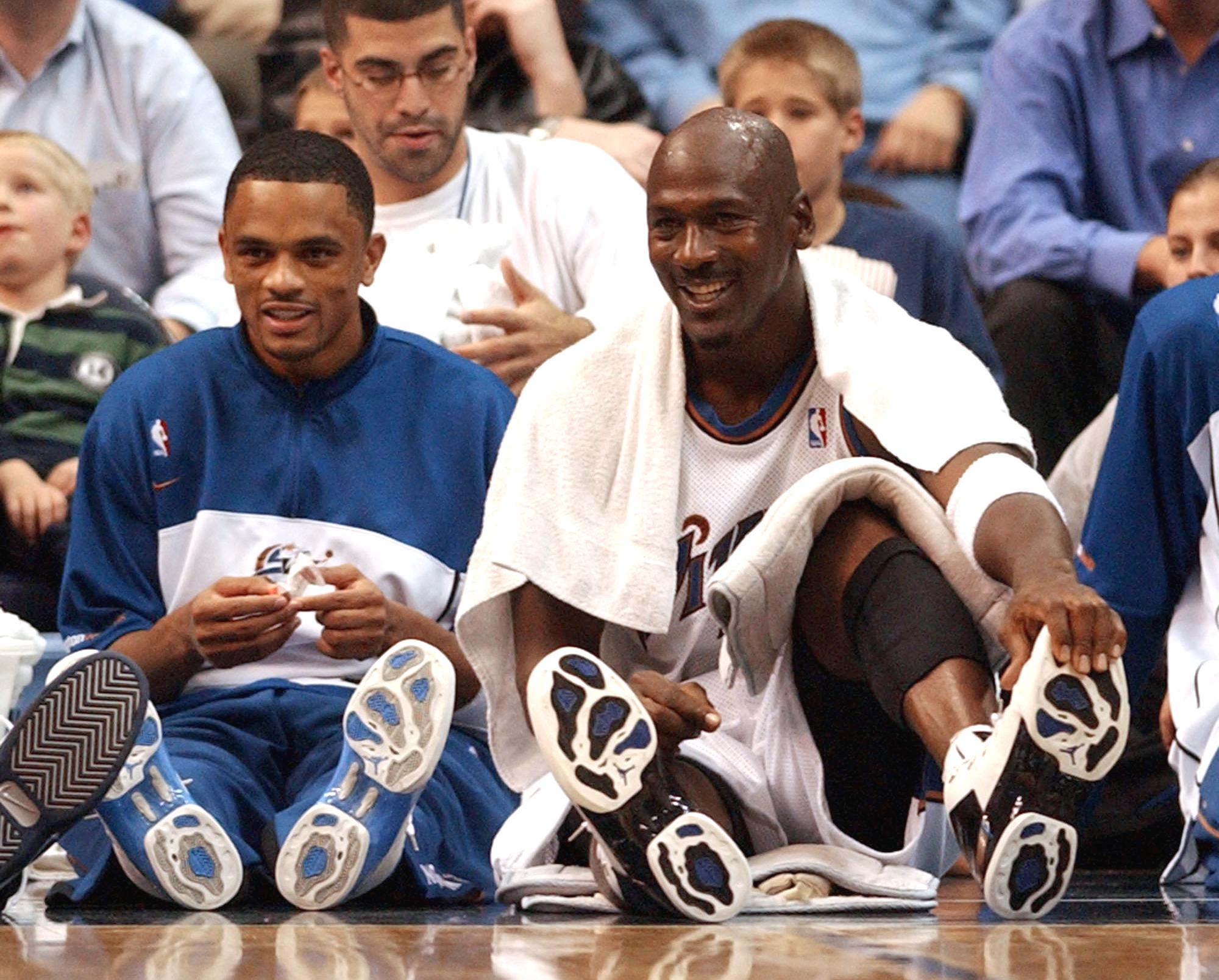 Wizards guard Michael Jordan (R) talks with teammate Juan Dixon