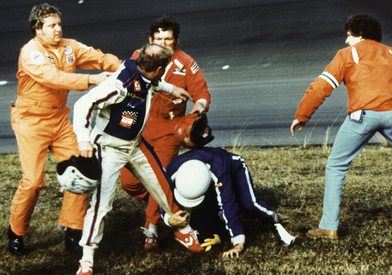 NASCAR driver Cale Yarborough wrestles with Bobby and Donnie Allison at the 1979 Daytona 500