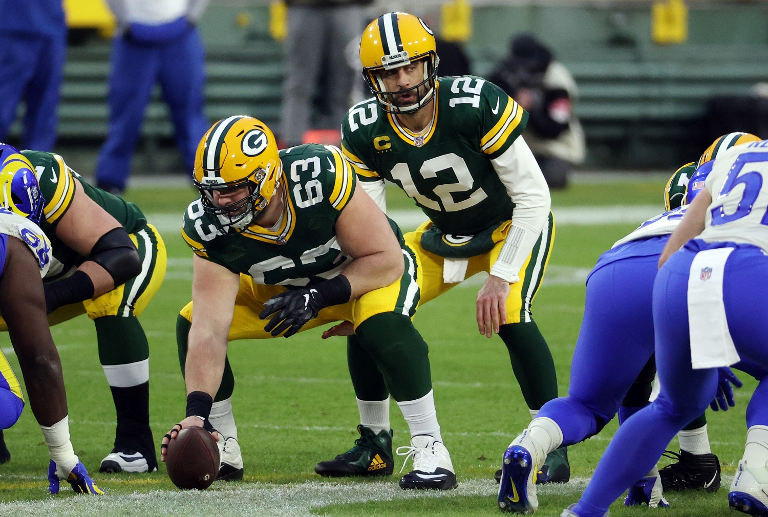 Aaron Rodgers prepares to take a snap from Packers center Corey Linsley during an NFC playoff game against the LA Rams.