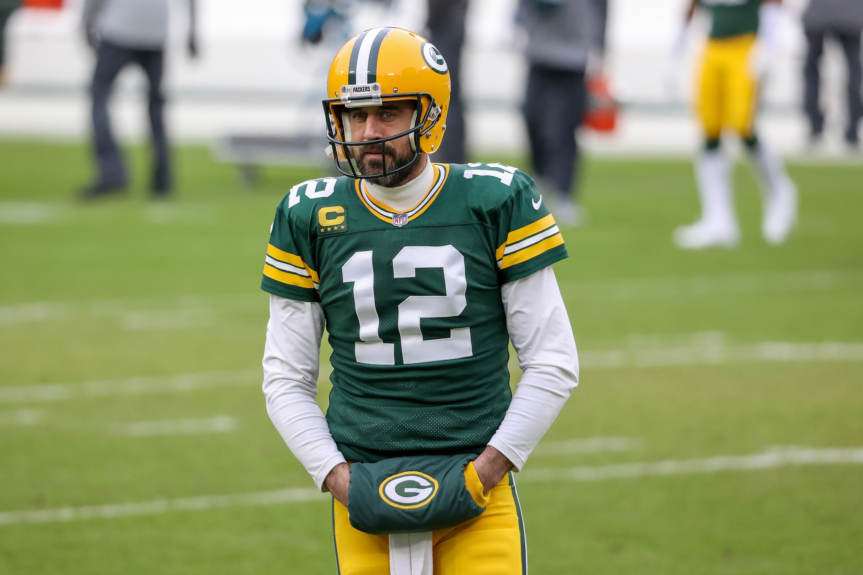 Aaron Rodgers looks on during the NFC Championship game