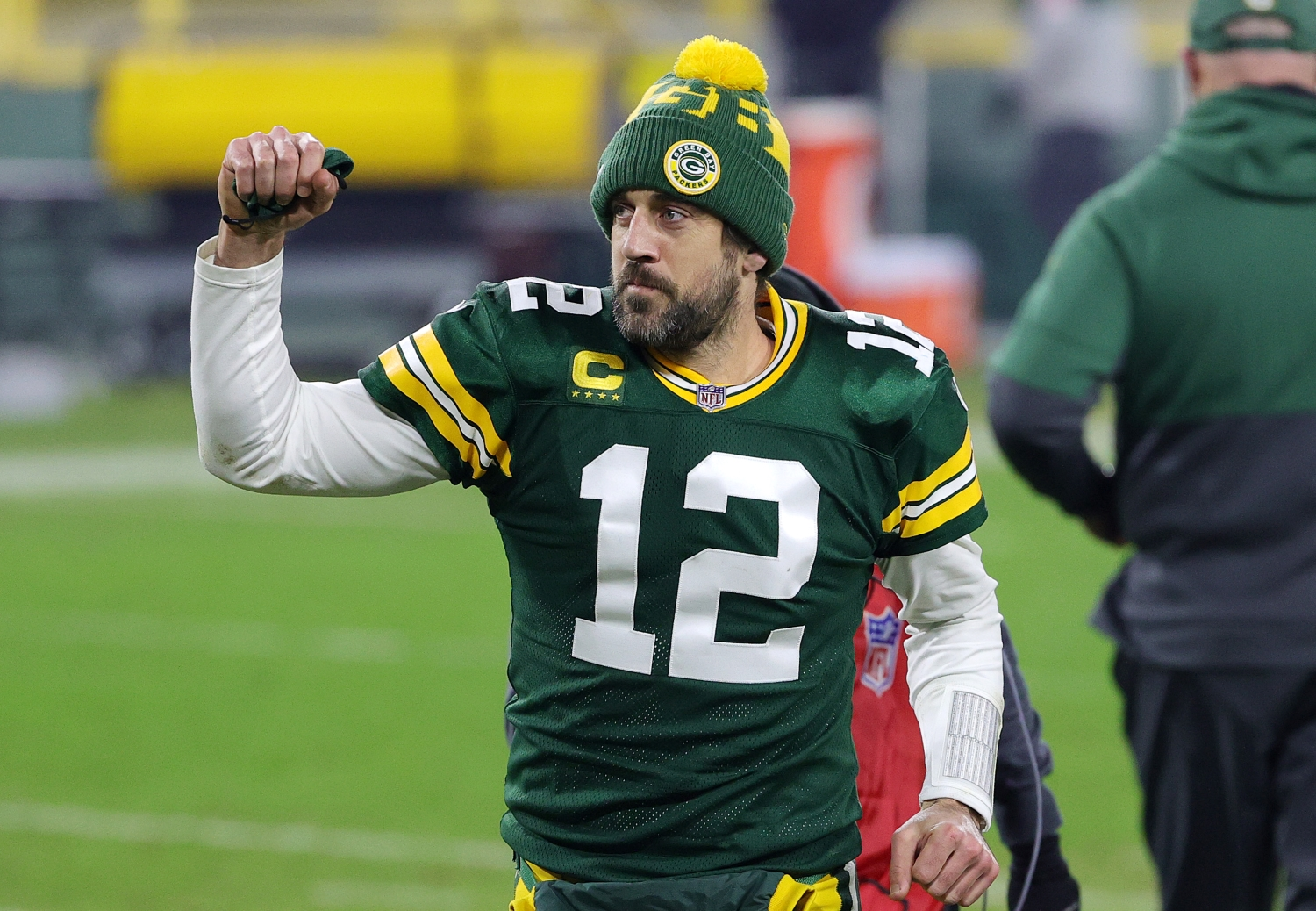 Aaron Rodgers of the Green Bay Packers celebrates defeating the Los Angeles Rams 32-18 in the NFC Divisional Playoff game.