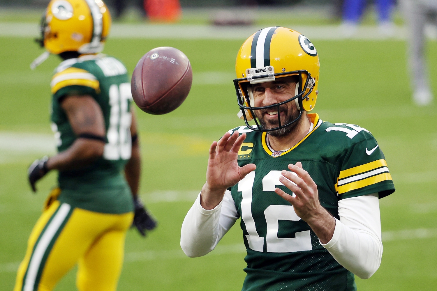 Aaron Rodgers of the Green Bay Packers warms up before the NFC Divisional Playoff game against the Los Angeles Rams.