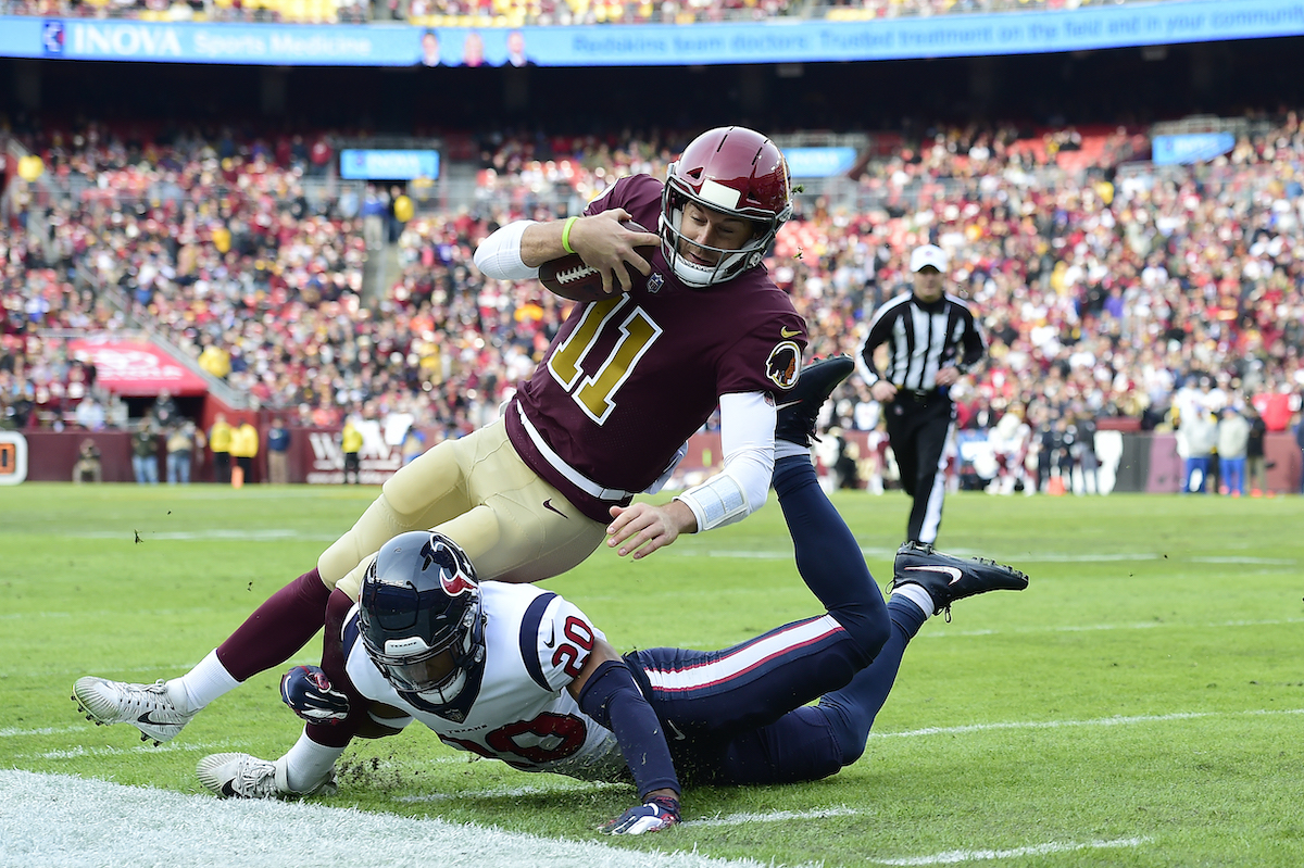 Alex Smith of the Washington Redskins is tackled by Justin Reid of the Houston Texans in 2018
