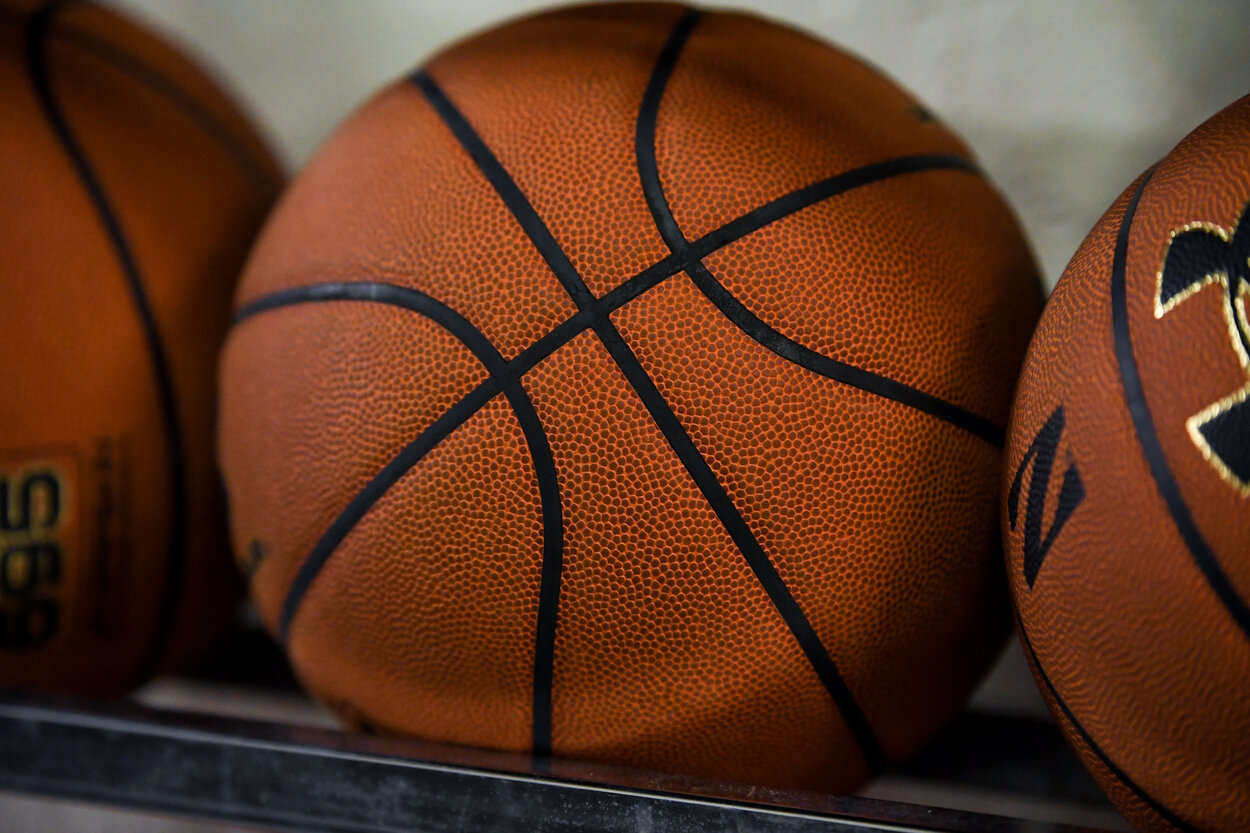 A stock image of a basketball during a college basketball game.
