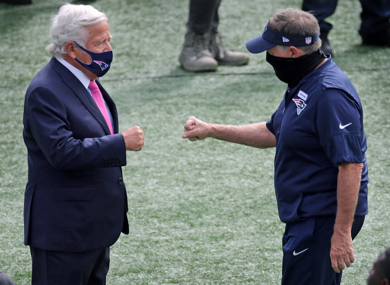 Patriots owner Robert Kraft (left) fist bumps with head coach Bill Belichick (right) as Belichick heads off the field following pre game warmups. The New England Patriot host the Las Vegas Raiders in an NFL regular season football game at Gillette Stadium in Foxborough, MA on Sept. 27, 2020. (Photo by Jim Davis/The Boston Globe via Getty Images)