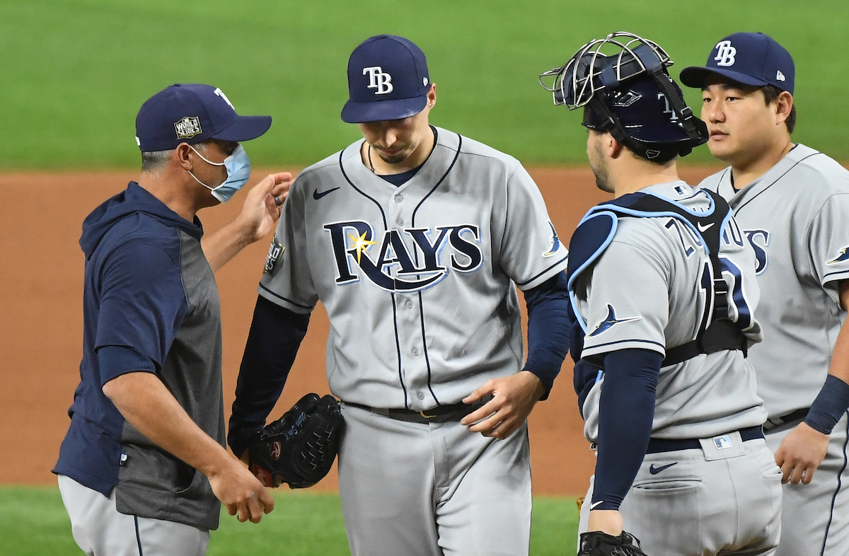Tampa Bay Rays manager Kevin Cash takes the ball from Blake Snell