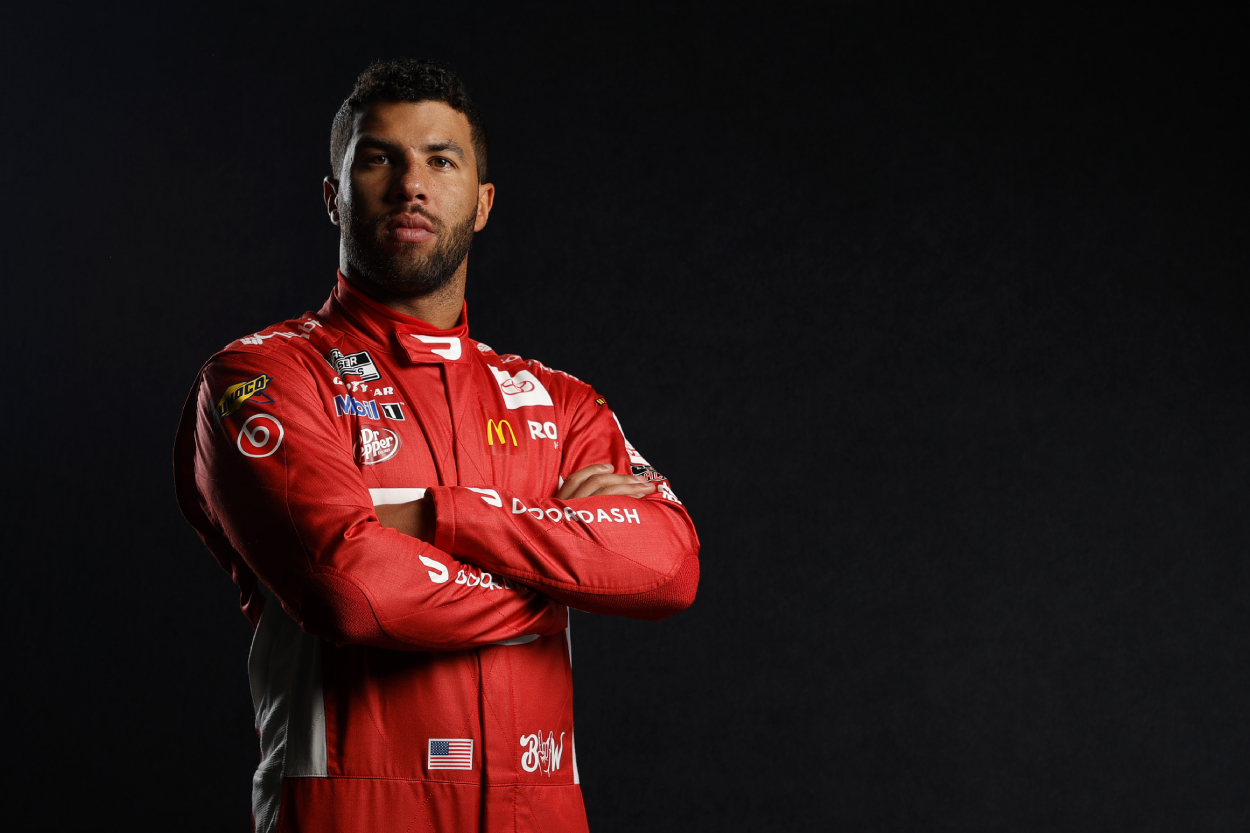 NASCAR driver Bubba Wallace poses at Daytona International Speedway.