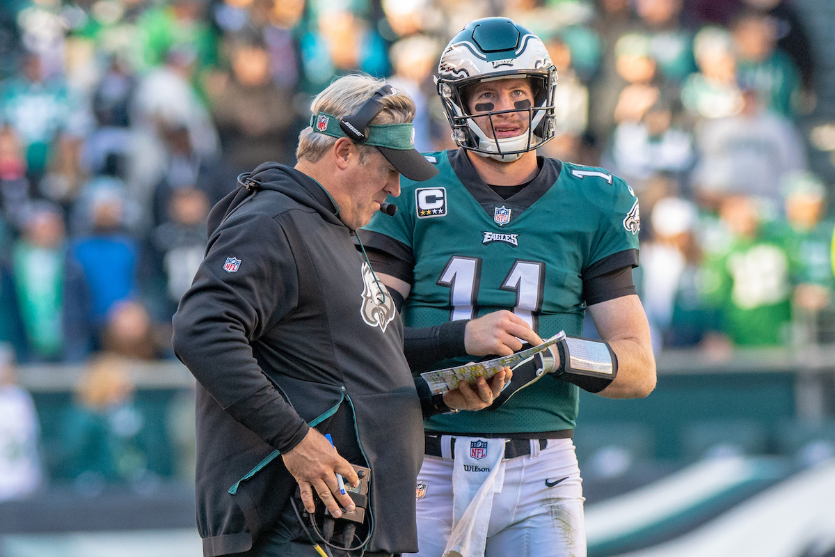 Philadelphia Eagles head coach Doug Pederson speaks to Carson Wentz