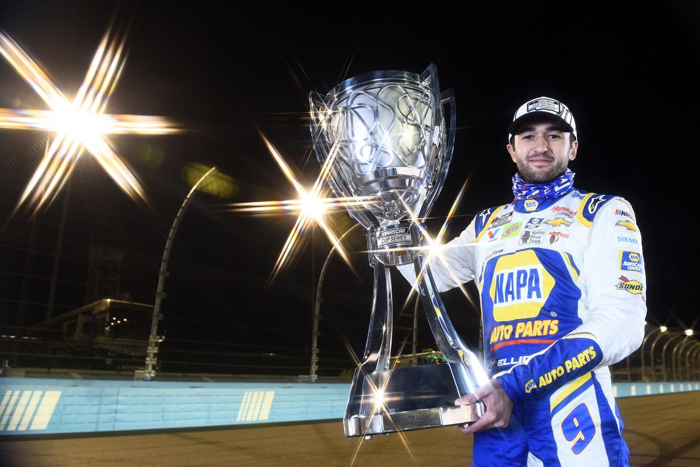 Chase Elliott holding NASCAR Cup trophy
