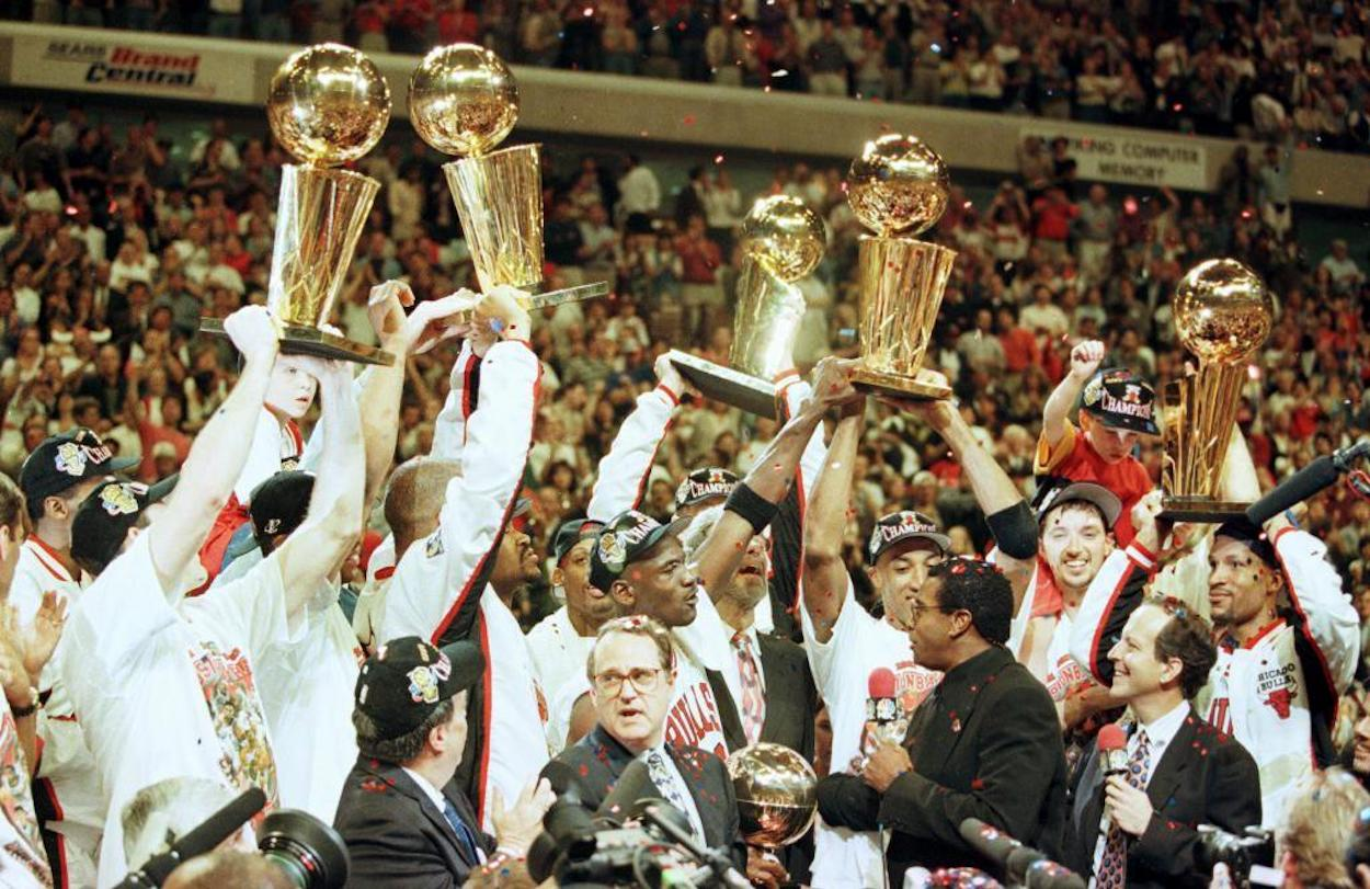 Michael Jordan and the Chicago Bulls celebrate after winning their fifth NBA title in seven years