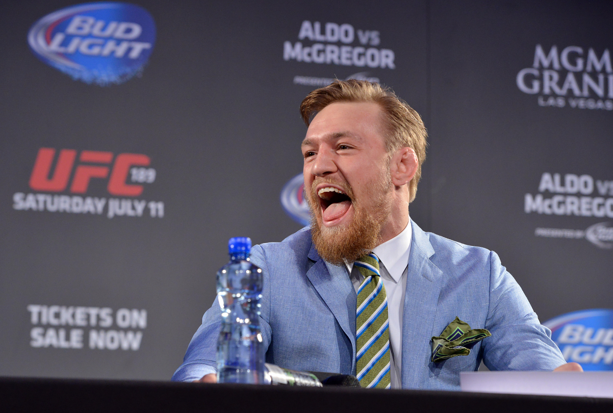 Conor McGregor laughing at a press conference