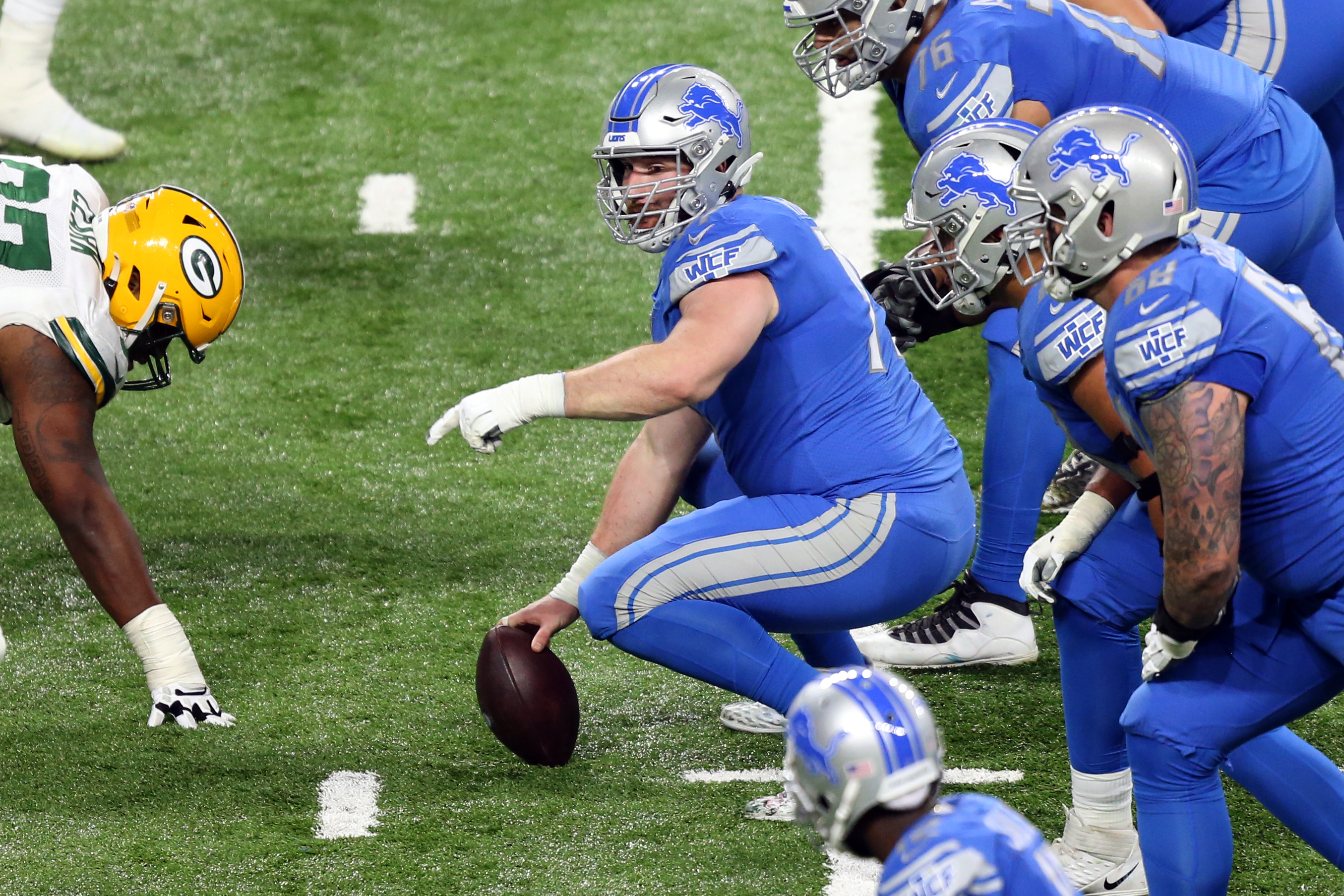 Detroit Lions center Frank Ragnow signals at the line of scrimmage