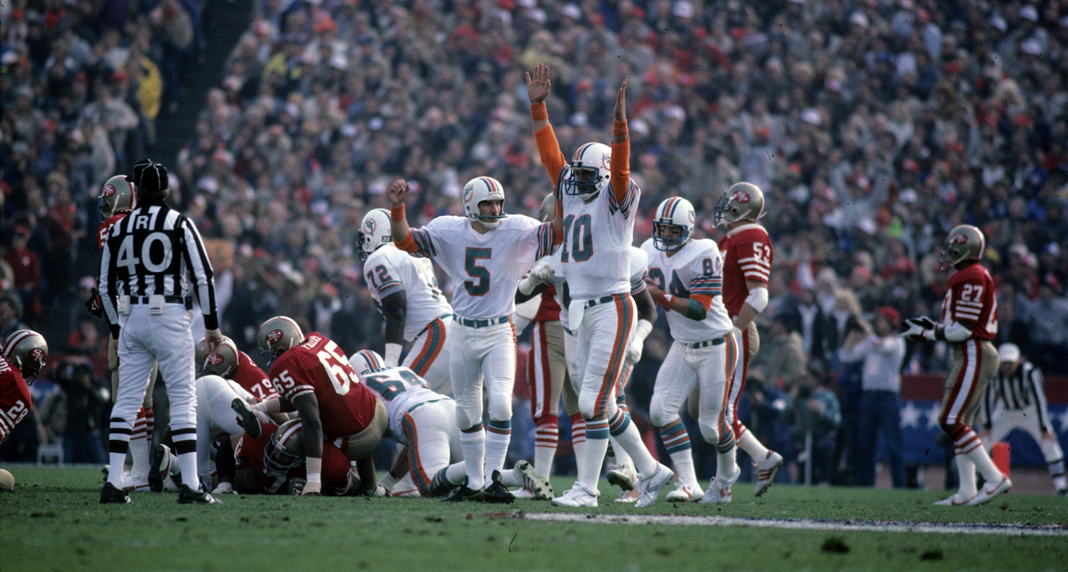 Dolphins kicker Uwe Von Schamann and holder Don Strock celebrate a field goal during Super Bowl XIX