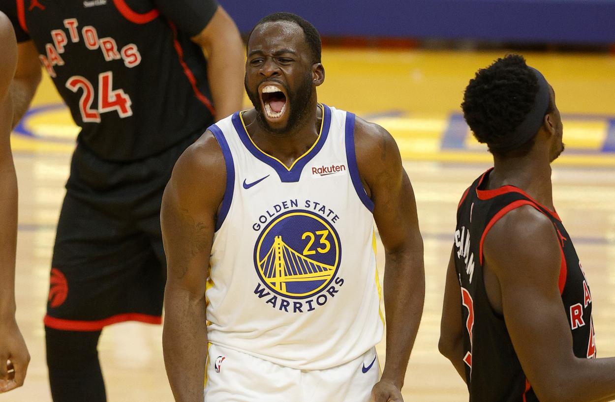 Warriors star Draymond Green celebrates against the Raptors.