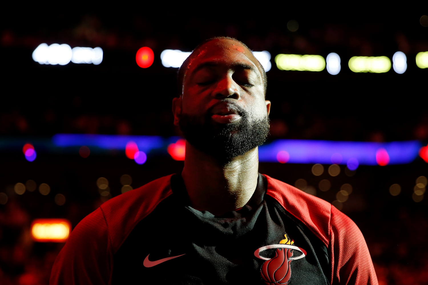 Dwyane Wade of the Miami Heat looks on during the playing of the national anthem prior to an NBA game.