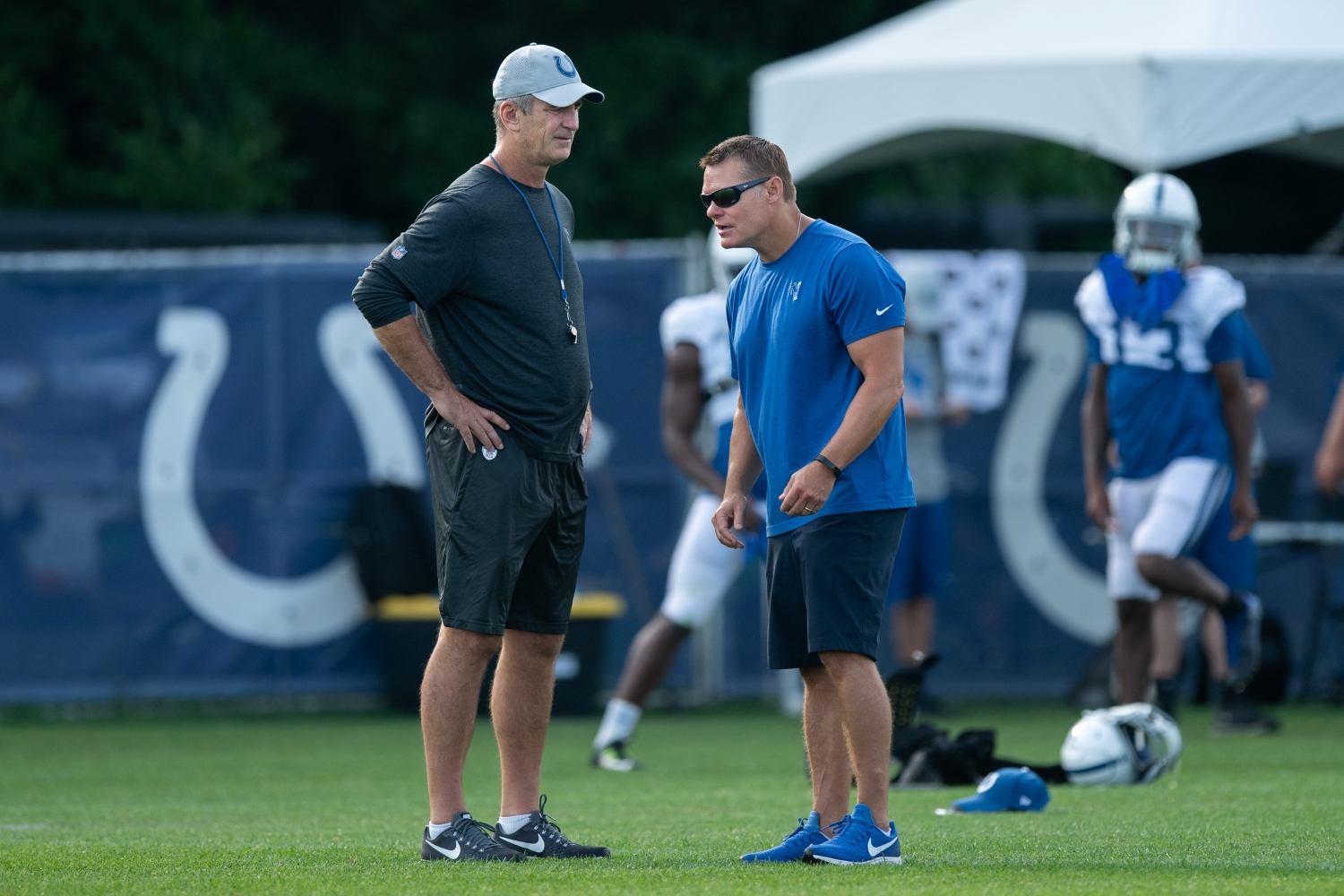 Indianapolis Colts general manager Chris Ballard talks to head coach Frank Reich on the field before the Indianapolis Colts training camp practice.