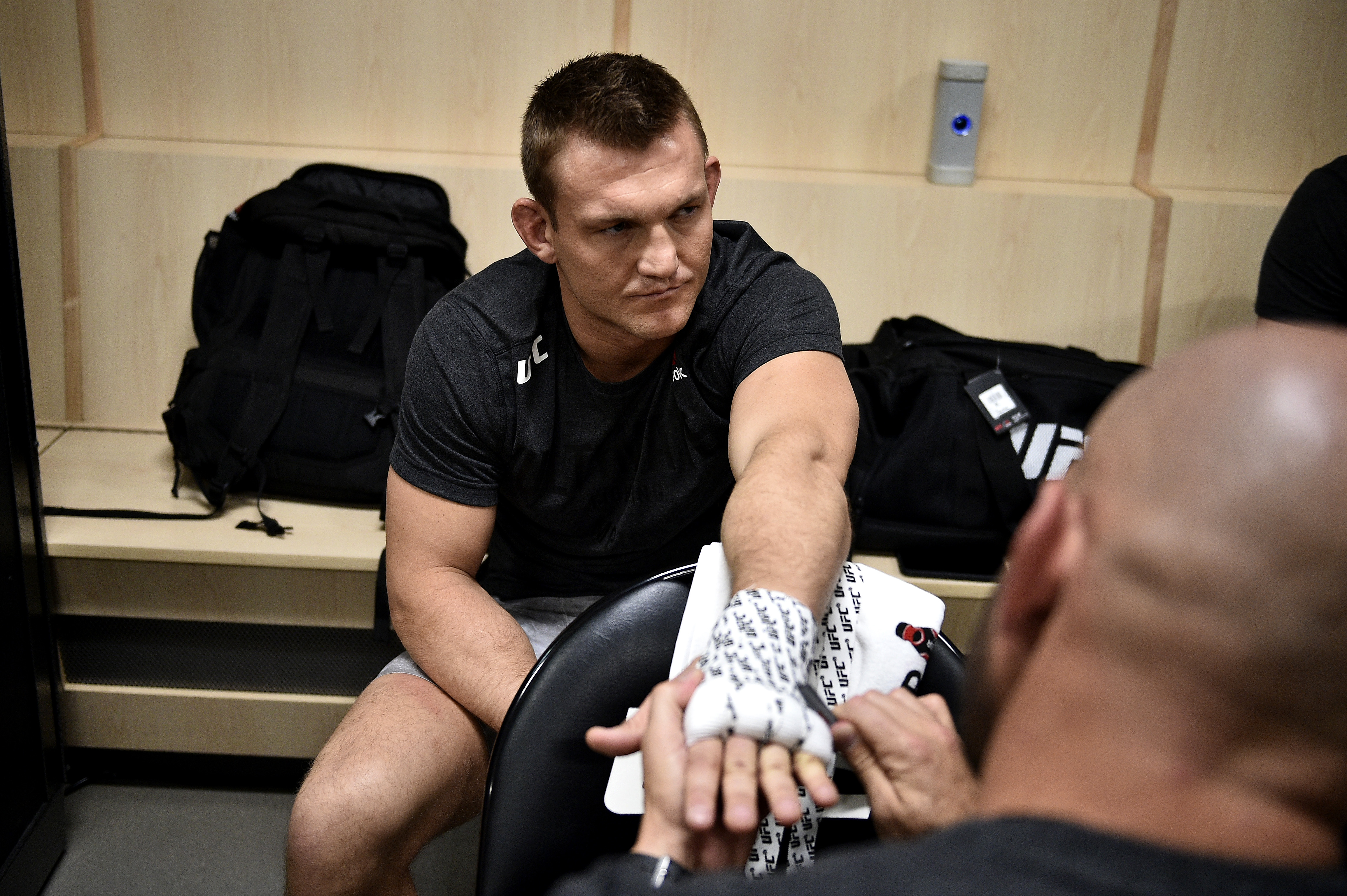 Ian Heinisch has his hands wrapped backstage before UFC 245