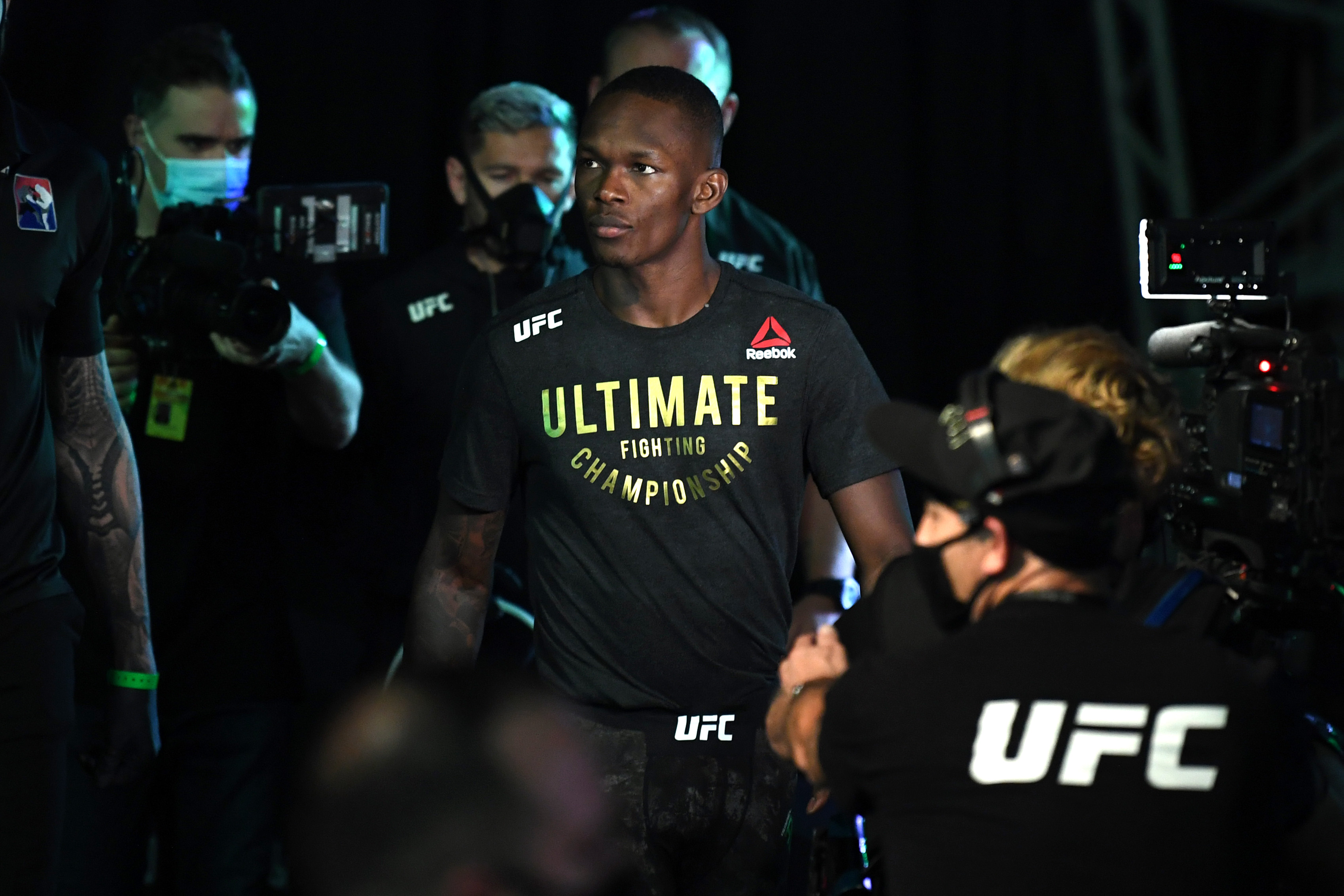 Israel Adesanya walks toward the Octagon