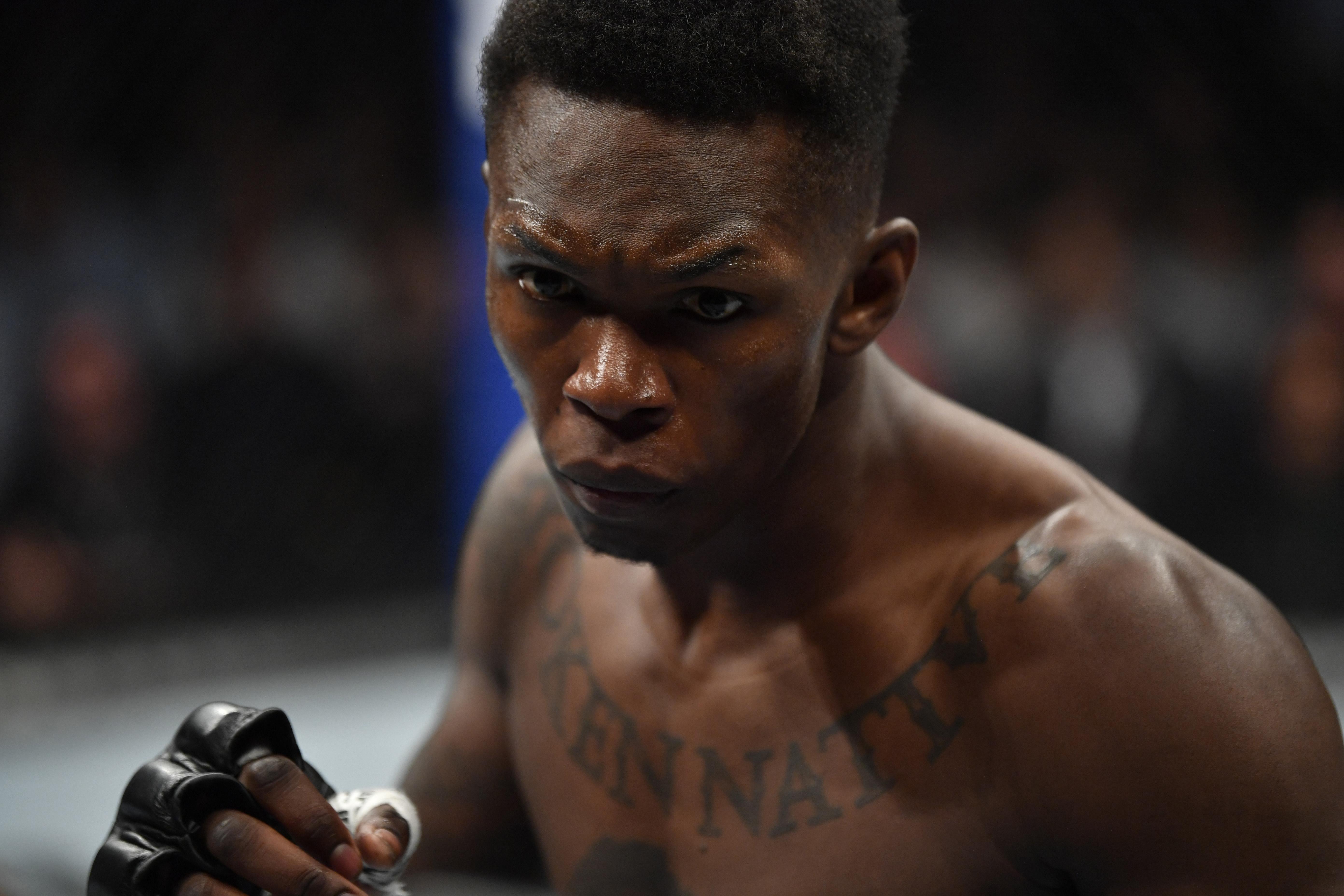 Israel Adesanya battles Yoel Romero in their UFC middleweight championship fight