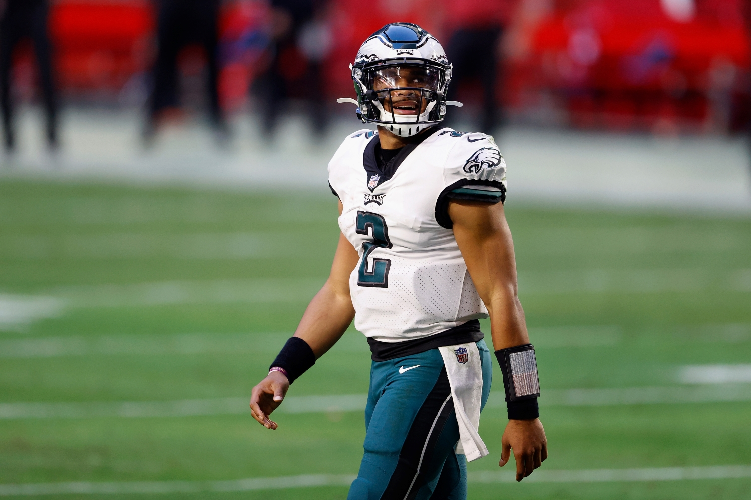 Quarterback Jalen Hurts of the Philadelphia Eagles walks off the field during a game against the Arizona Cardinals.