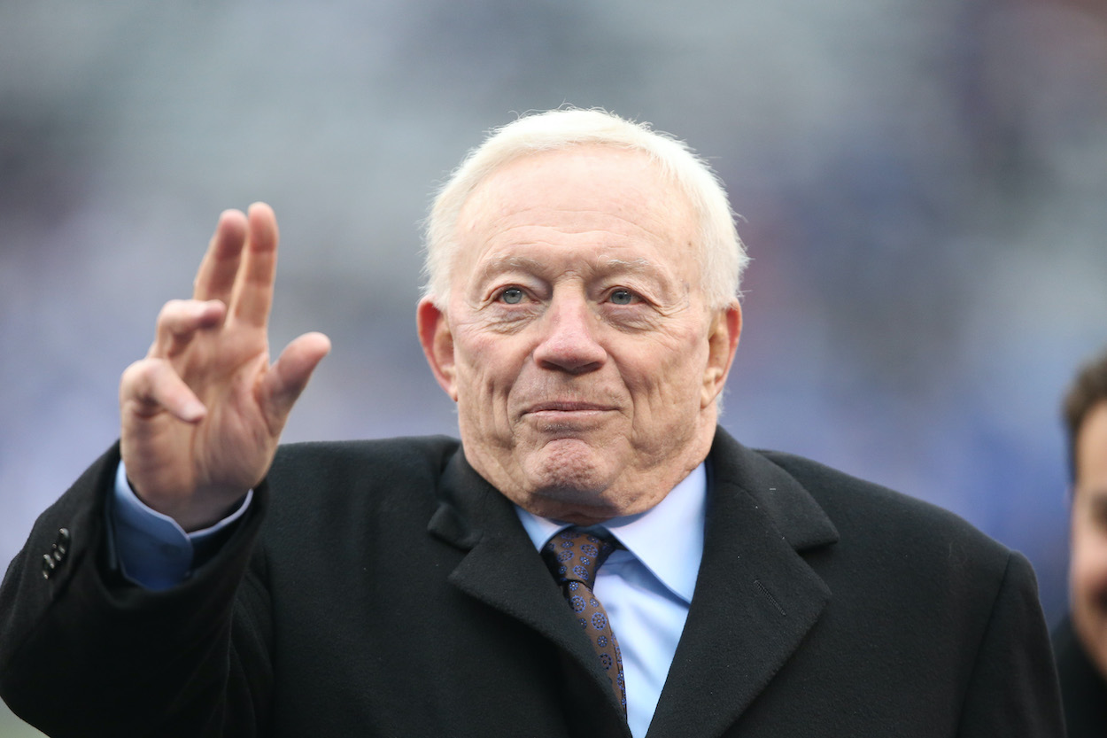 Dallas Cowboys owner Jerry Jones waves to fans before a game